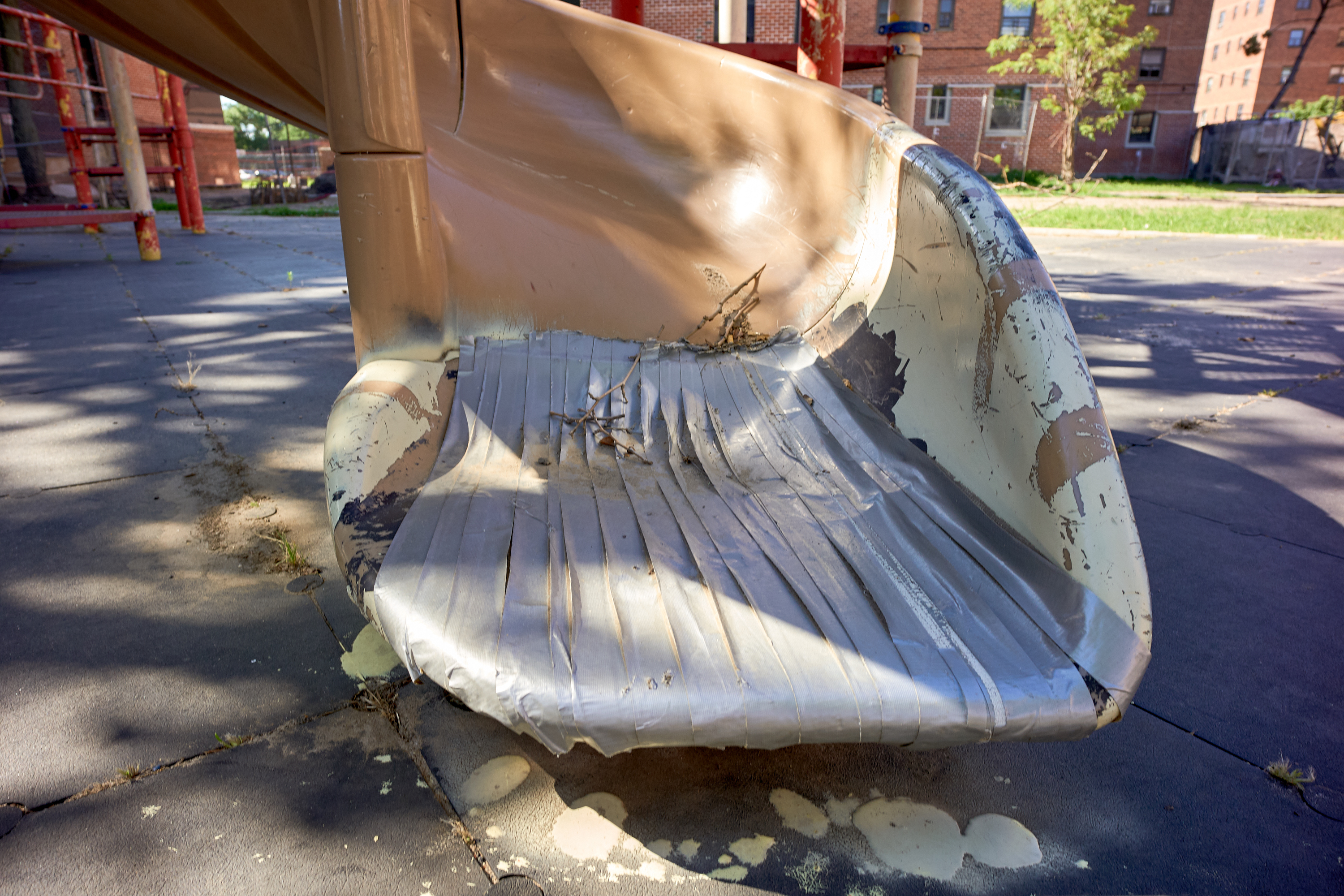 A slide with makeshift repairs at the Gravesend Houses, July 14, 2020.