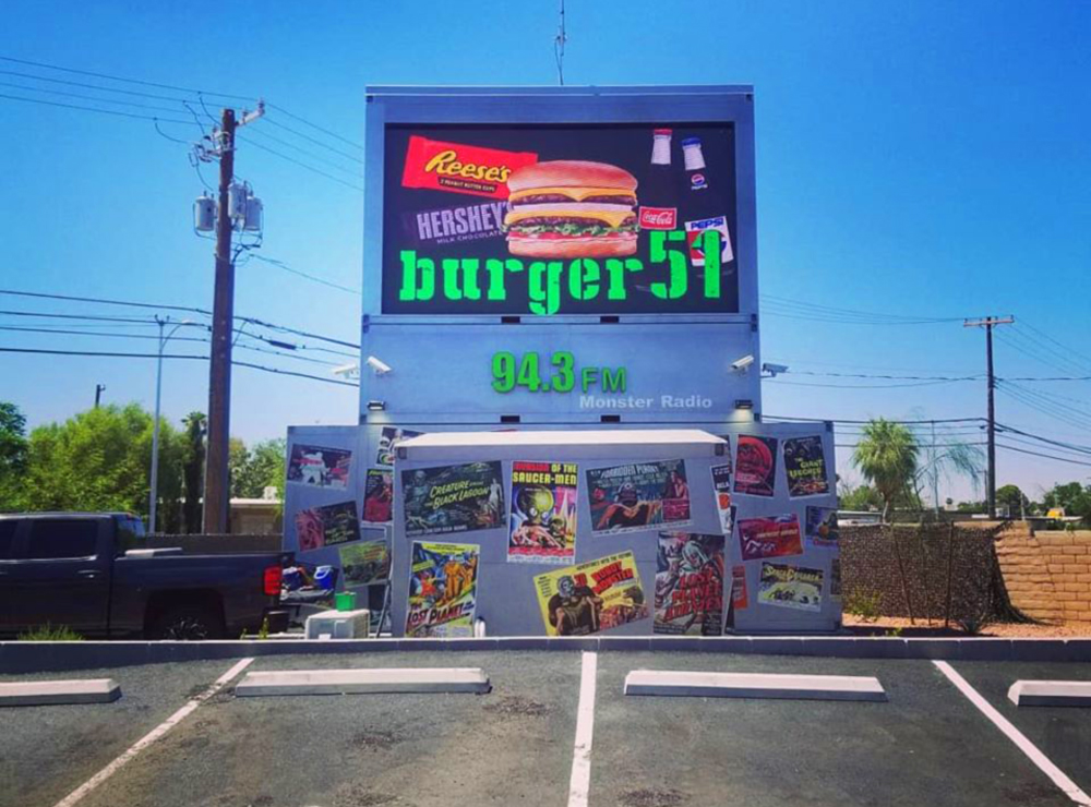 The screen at the Burger51 drive-in movie theater and drive-thru burger stand.