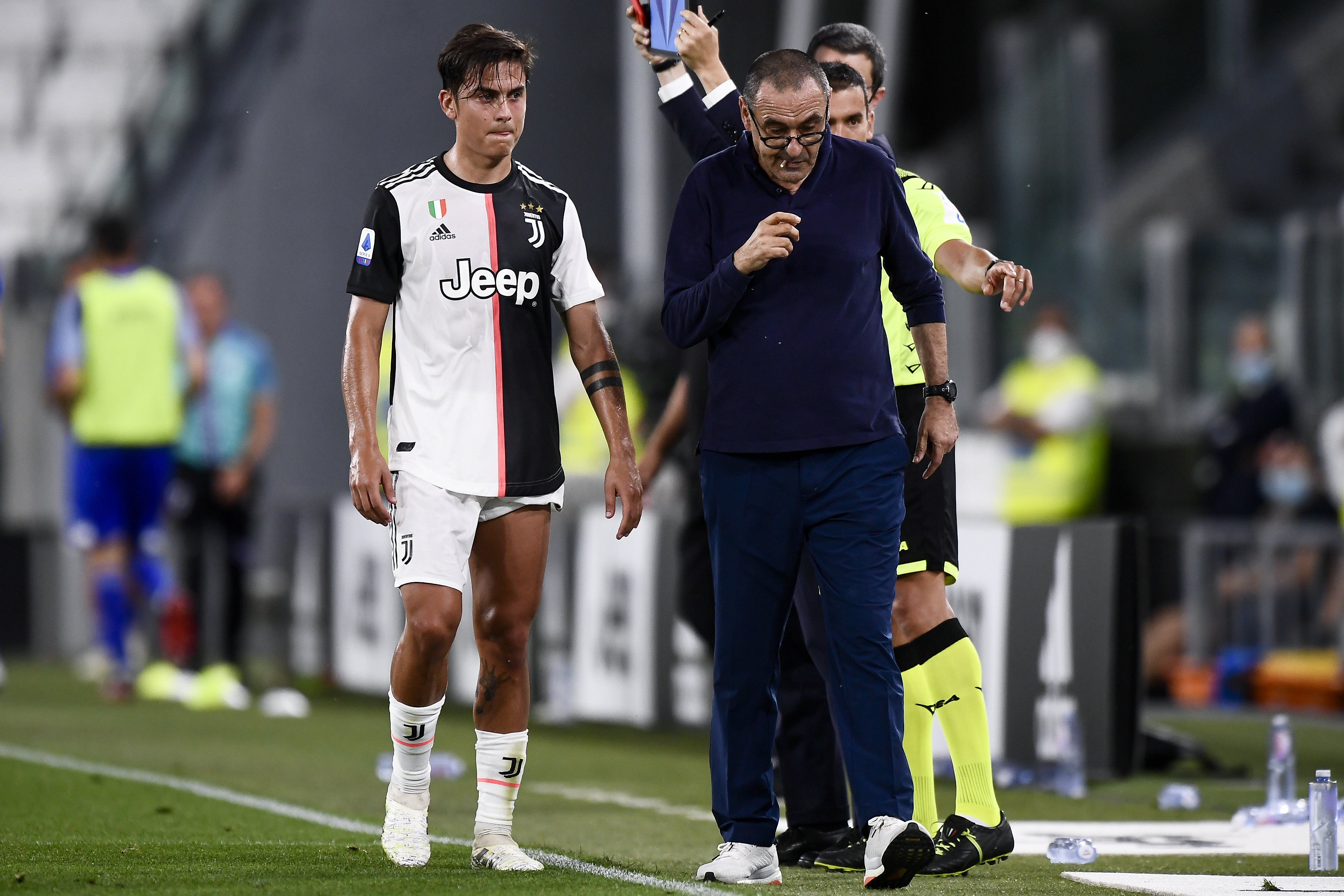 Paulo Dybala of Juventus FC leaves the pitch after an injury...
