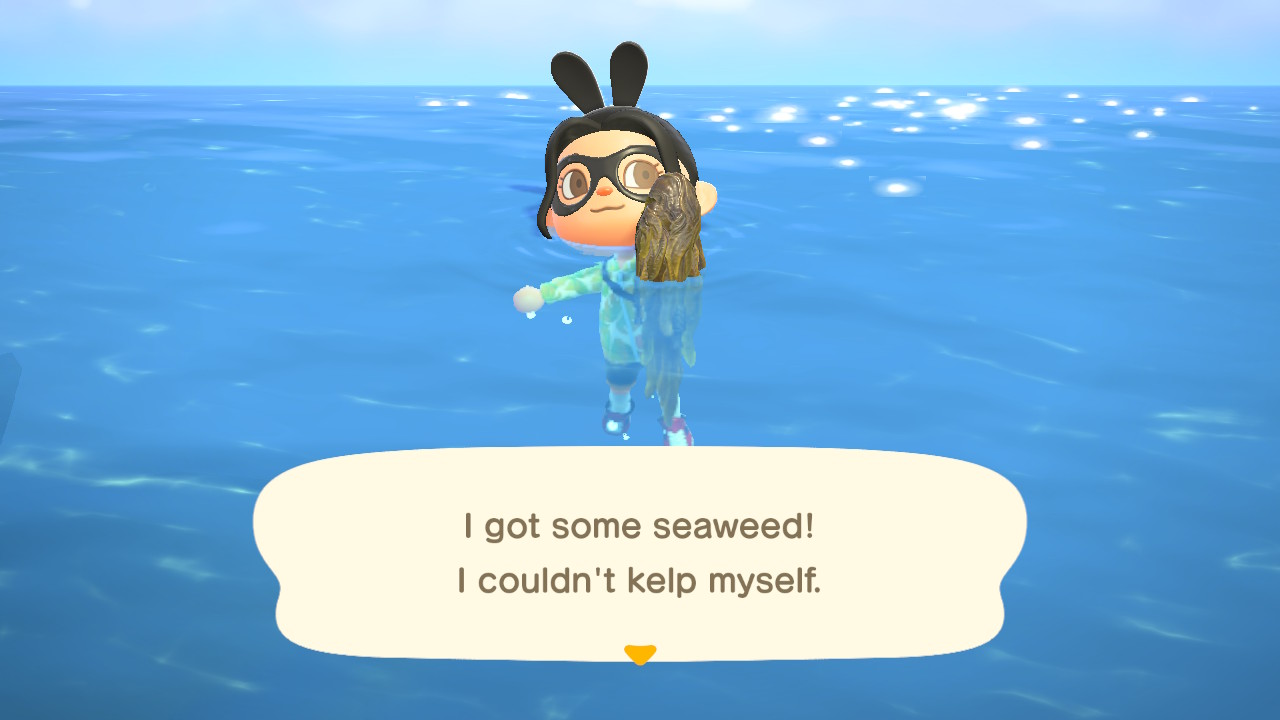 An Animal Crossing character holds up a clump of seaweed in the ocean
