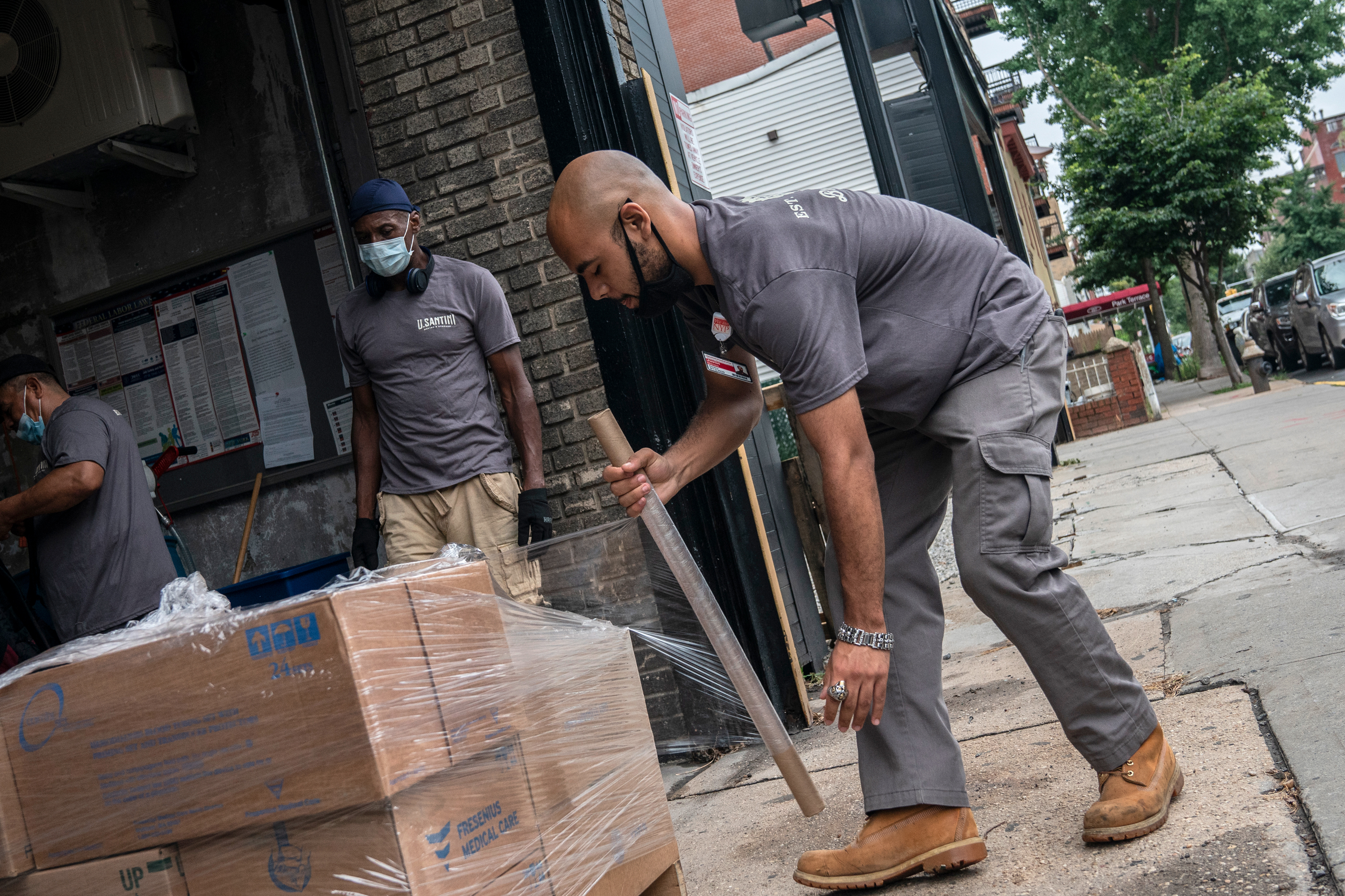 Santini Moving & Storage employees wrap boxes at their Park Slope warehouse, July 24, 2020.
