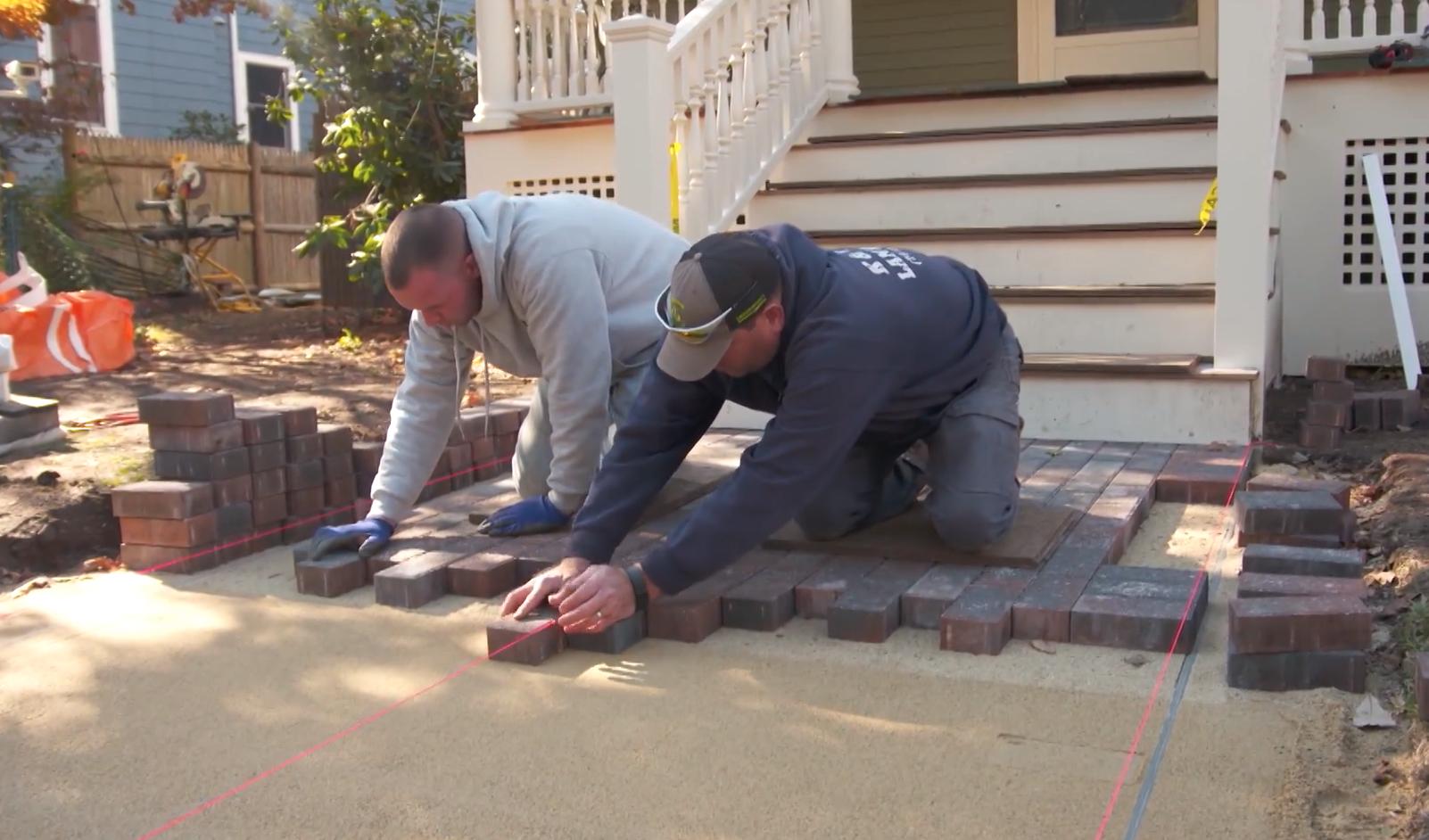 Building a concrete paver walkway.