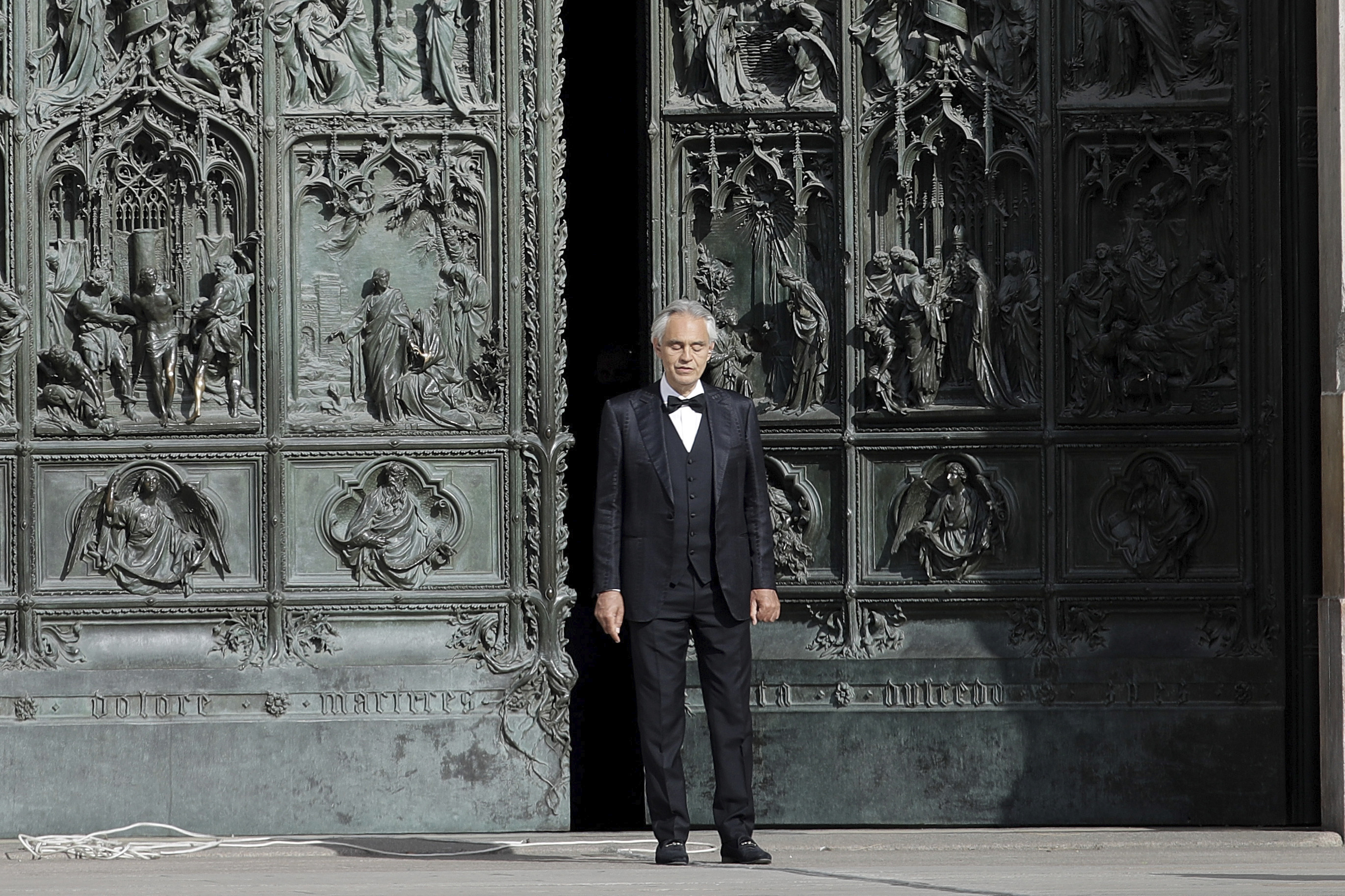 Italian singer Andrea Bocelli performs outside the Duomo cathedral, in Milan, Italy, earlier this year.