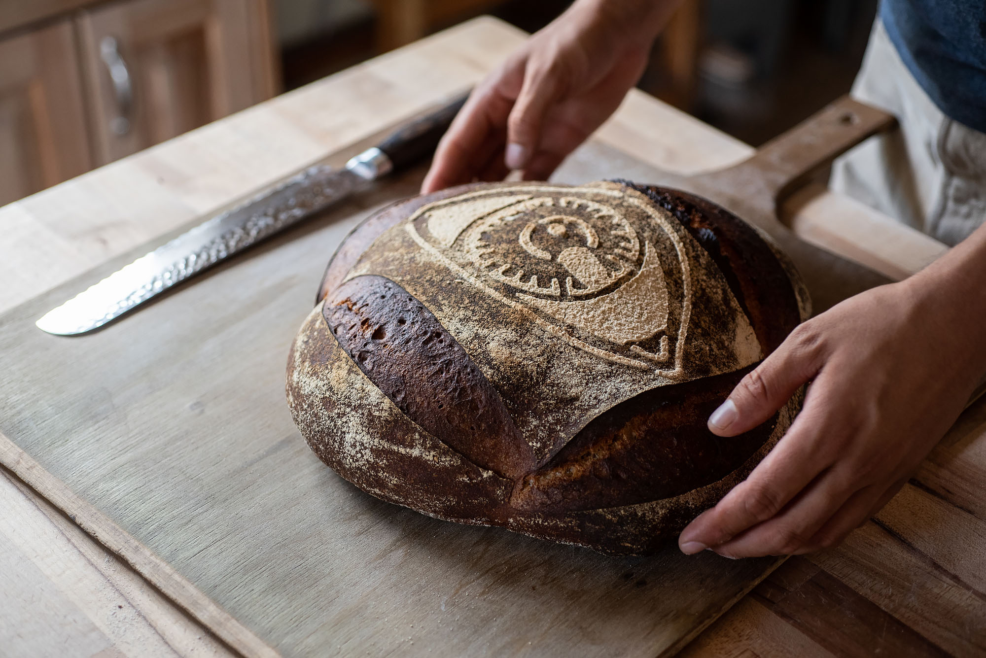 A dark loaf of bread fresh from the oven.