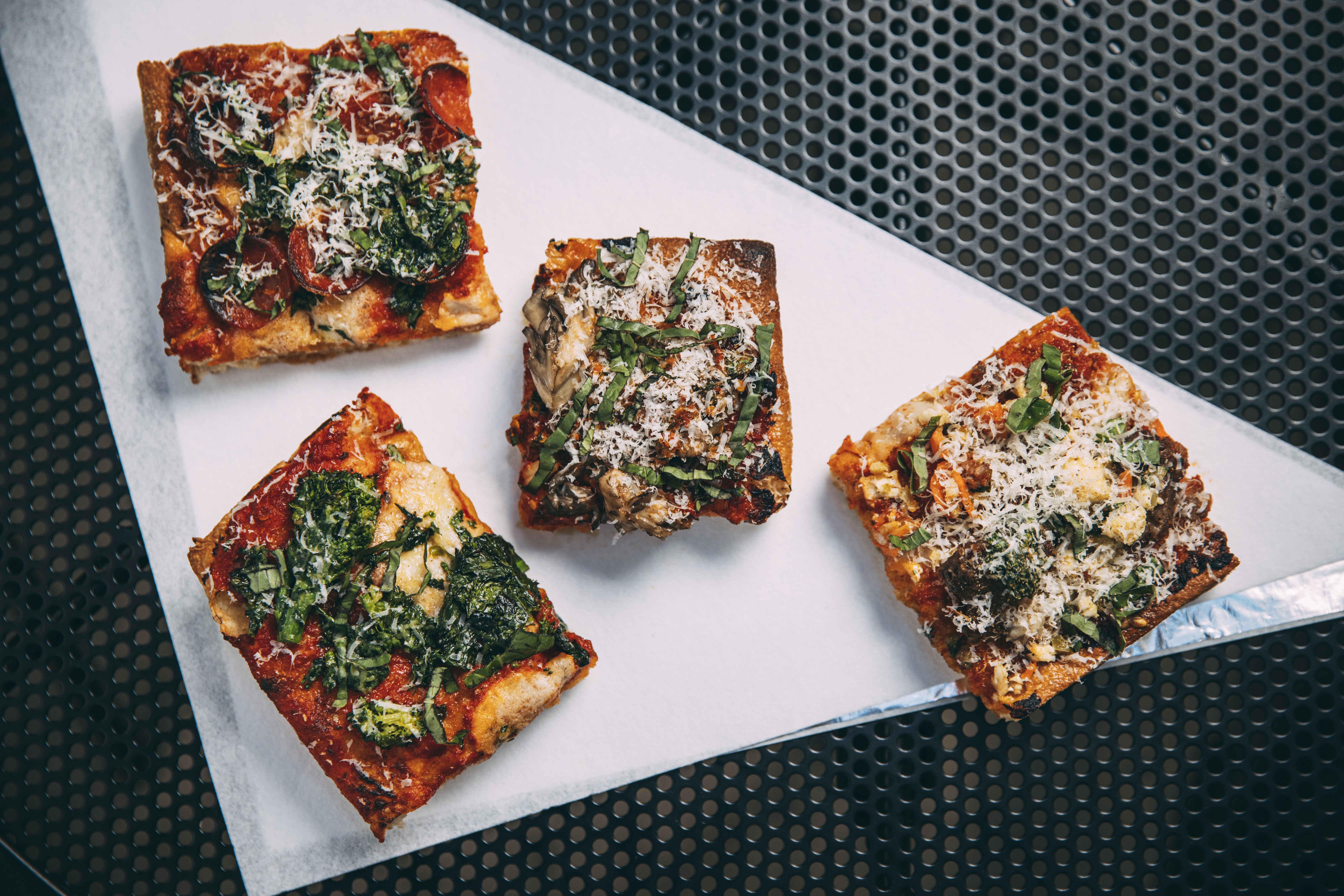 Four square slices of pizza