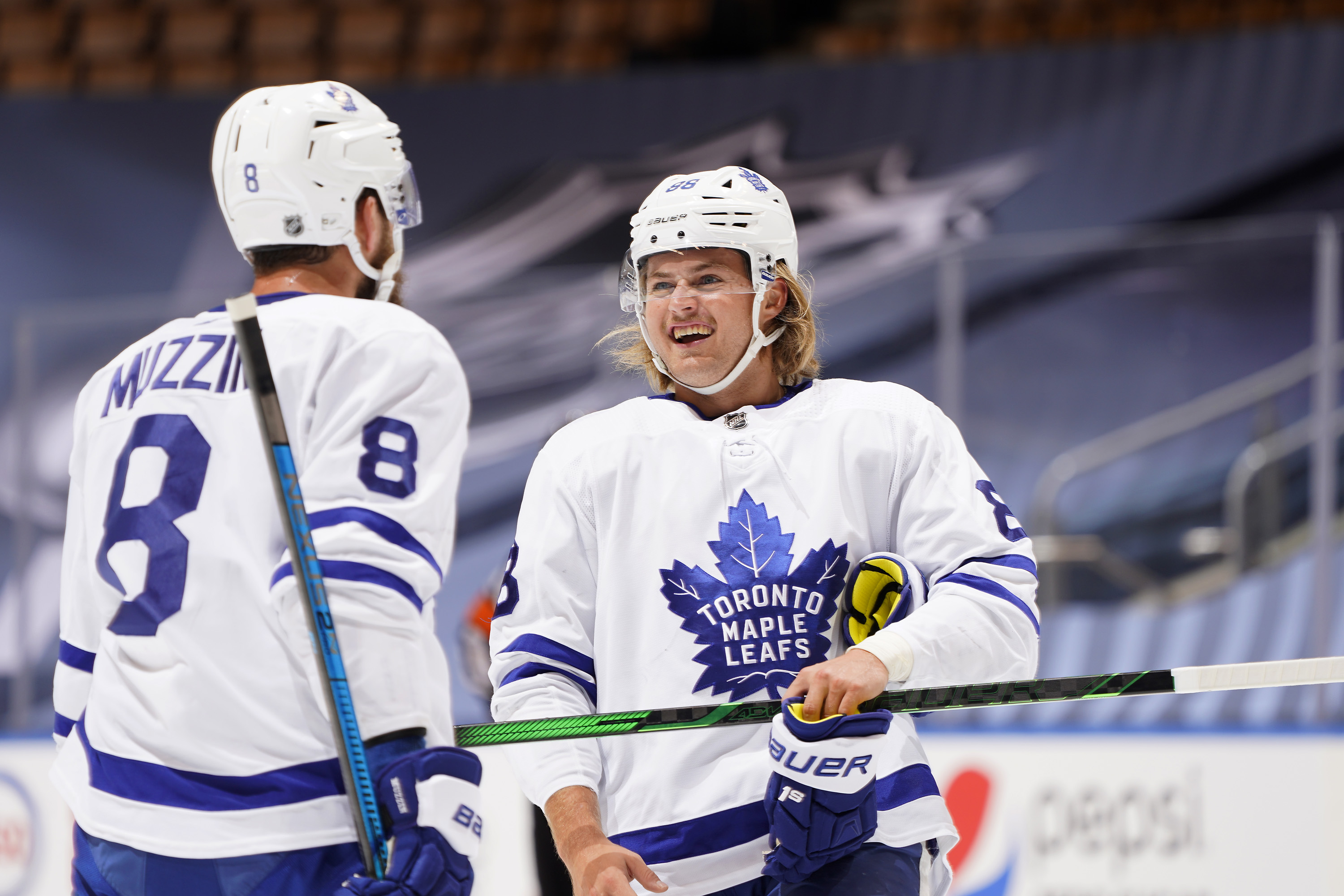 TORONTO, ONTARIO - JULY 28: William Nylander #88 and Jake Muzzin #8 of the Toronto Maple Leafs talk on the ice during the first period of an exhibition game against the Montreal Canadiens prior to the 2020 NHL Stanley Cup Playoffs at Scotiabank Arena on July 28, 2020 in Toronto, Ontario.