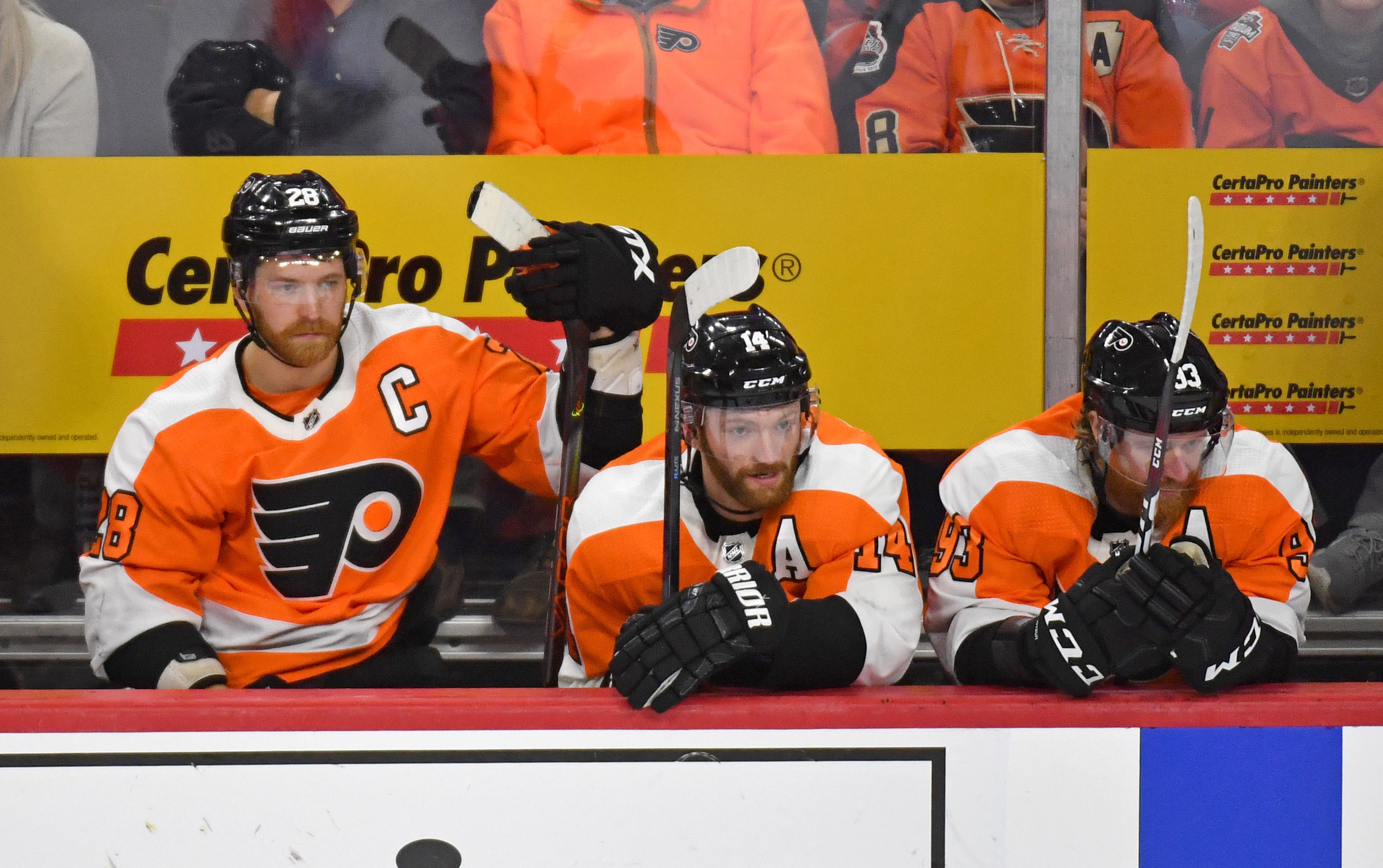 Philadelphia Flyers center Claude Giroux, center Sean Couturier and right wing Jakub Voracek on the bench late in the third period of win against the Columbus Blue Jackets at Wells Fargo Center.