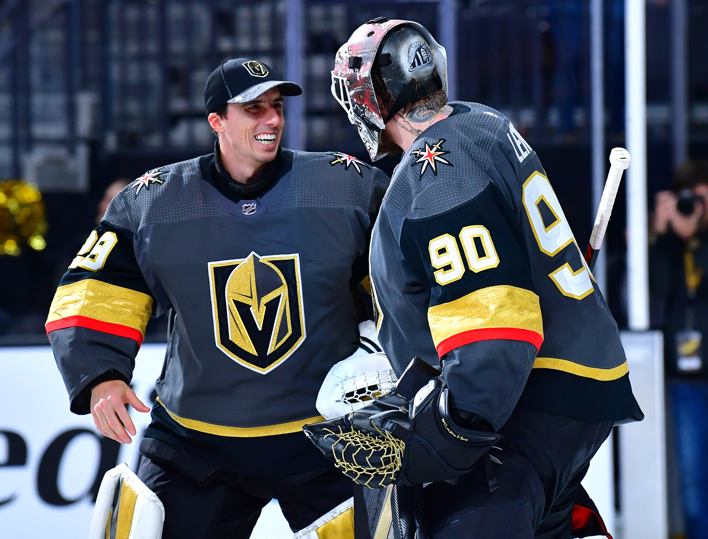 Las Vegas, Nevada, USA; Vegas Golden Knights goaltender Robin Lehner is congratulated by goaltender Marc-Andre Fleury after shutting out the New Jersey Devils 3-0 game at T-Mobile Arena.