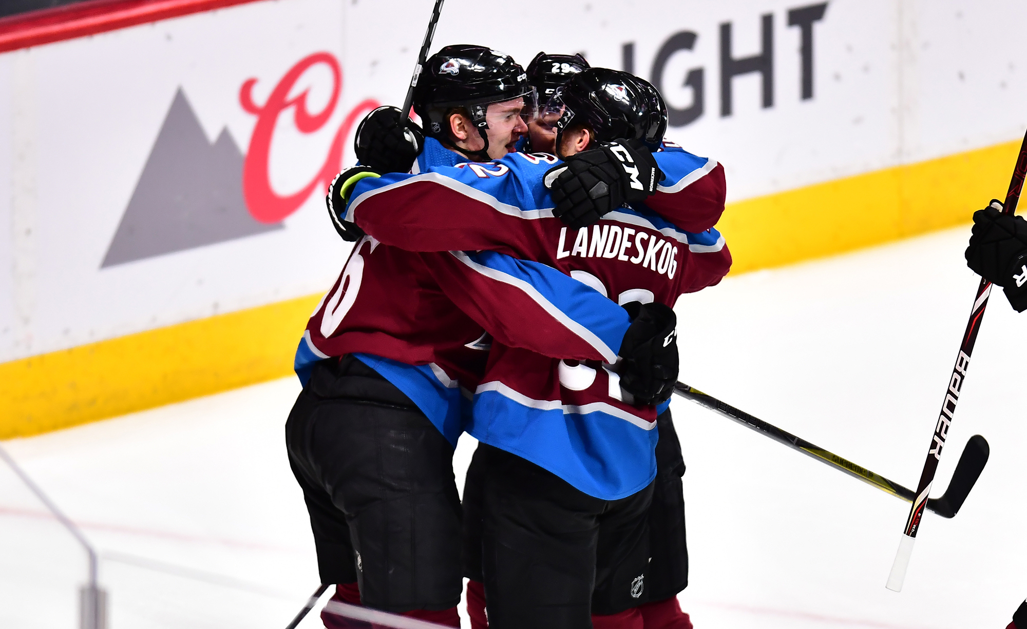 Colorado Avalanche right wing Mikko Rantanen celebrates his goal with center Nathan MacKinnon and left wing Gabriel Landeskog in the first period against the Los Angeles Kings at the Pepsi Center.