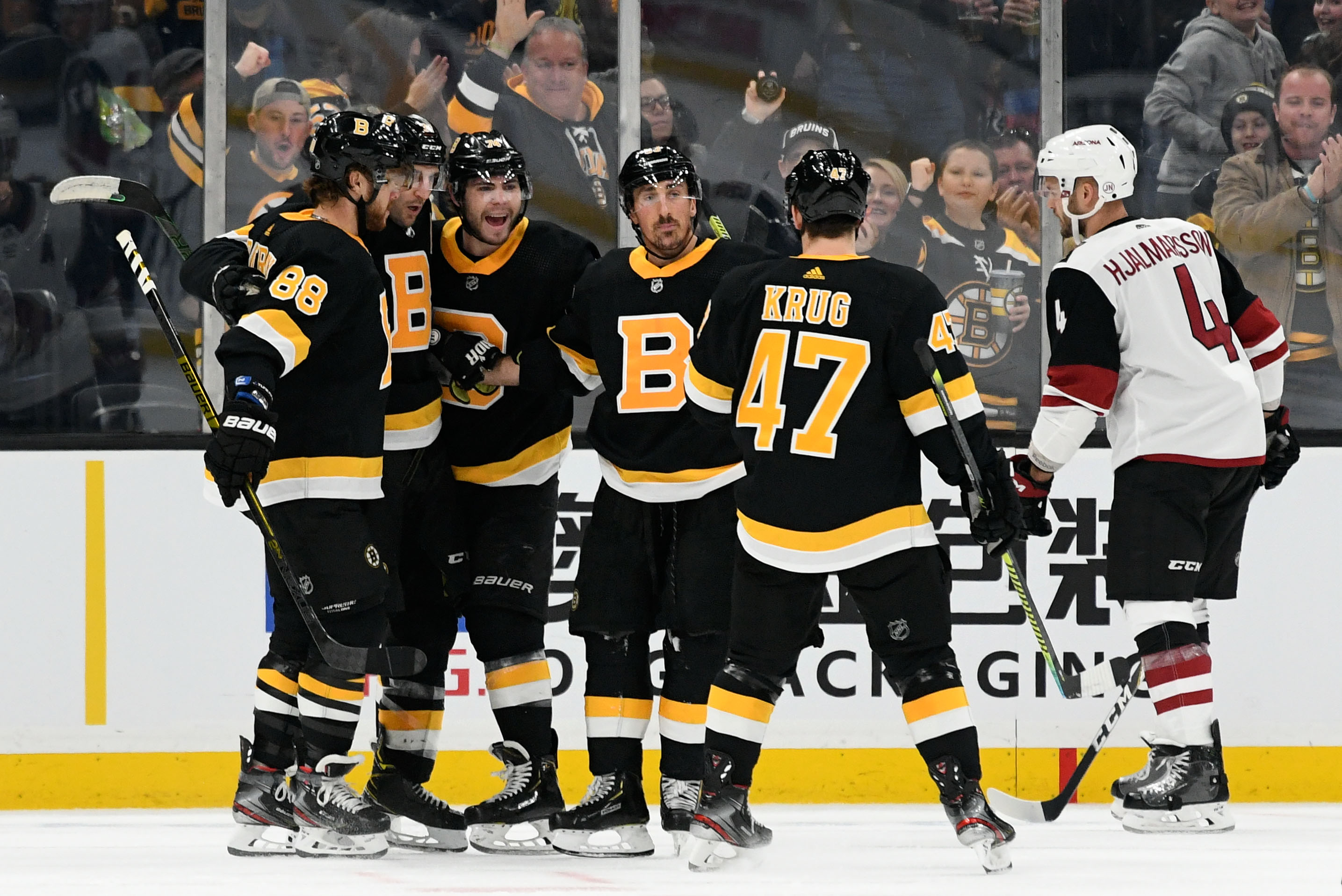 Boston Bruins center Patrice Bergeron celebrates with right wing David Pastrnak, left wing Brad Marchand, left wing Jake DeBrusk, and defenseman Torey Krug after scoring against the Arizona Coyotes during the second period at the TD Garden.