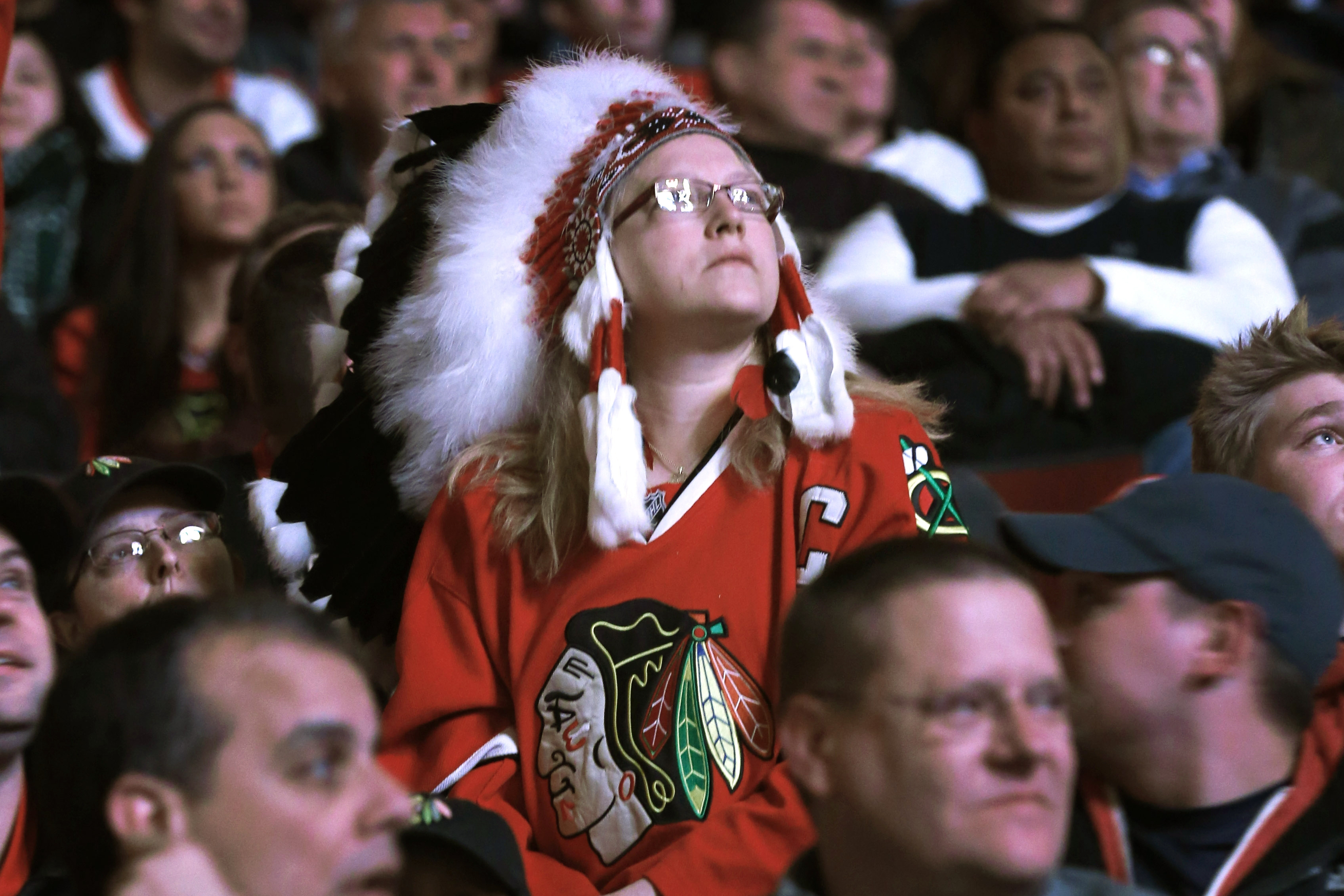 The Blackhawks will ban headdresses, such as the one worn by this fan in this 2013 photo, at future games.