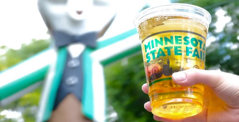 A Minnesota State Beer held aloft at the fair