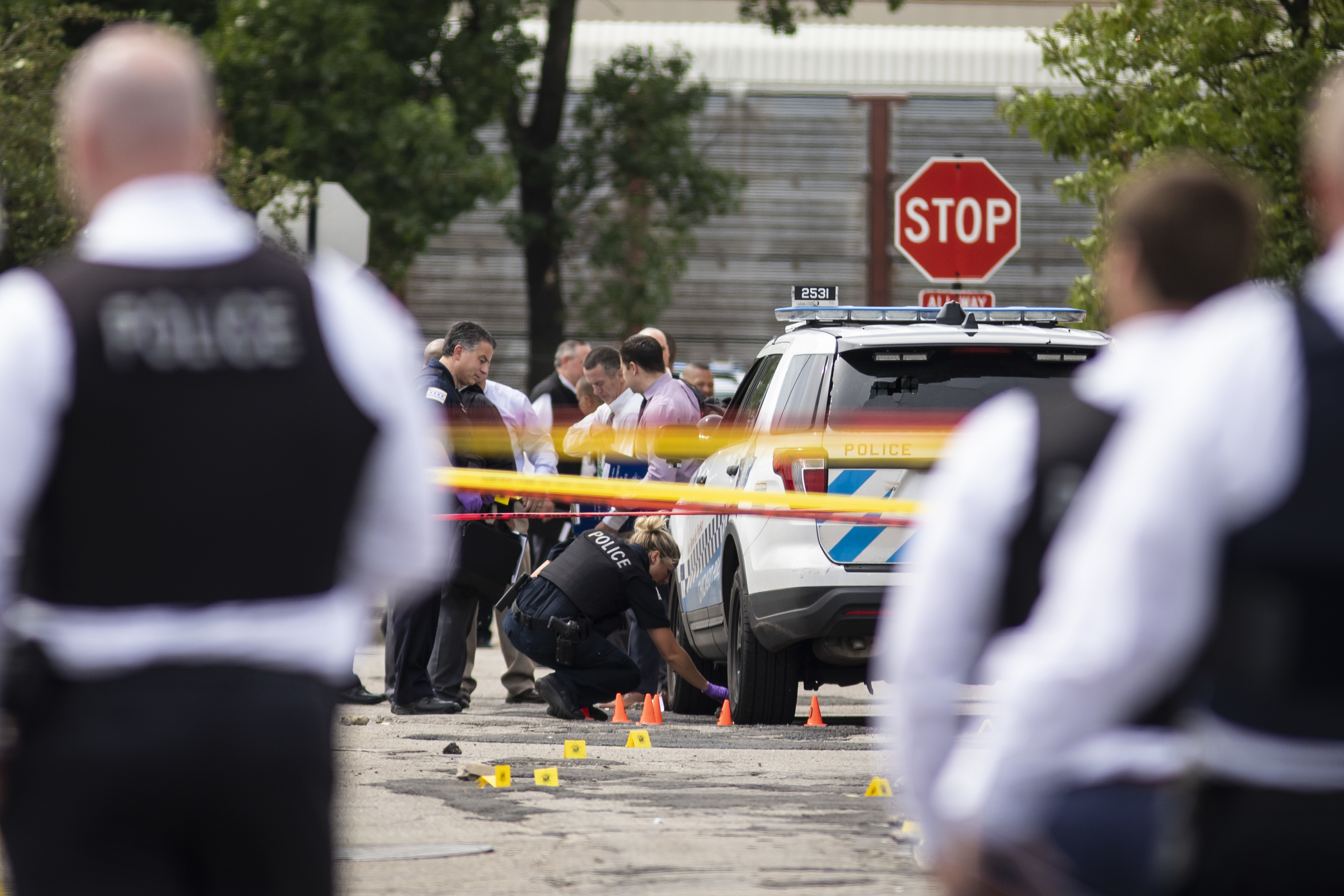 Chicago Police investigate at the 25th District station, 5555 W. Grand Ave., on the Northwest Side, after multiple officers were shot outside the station Thursday morning. The suspect was also shot multiple times in the incident.
