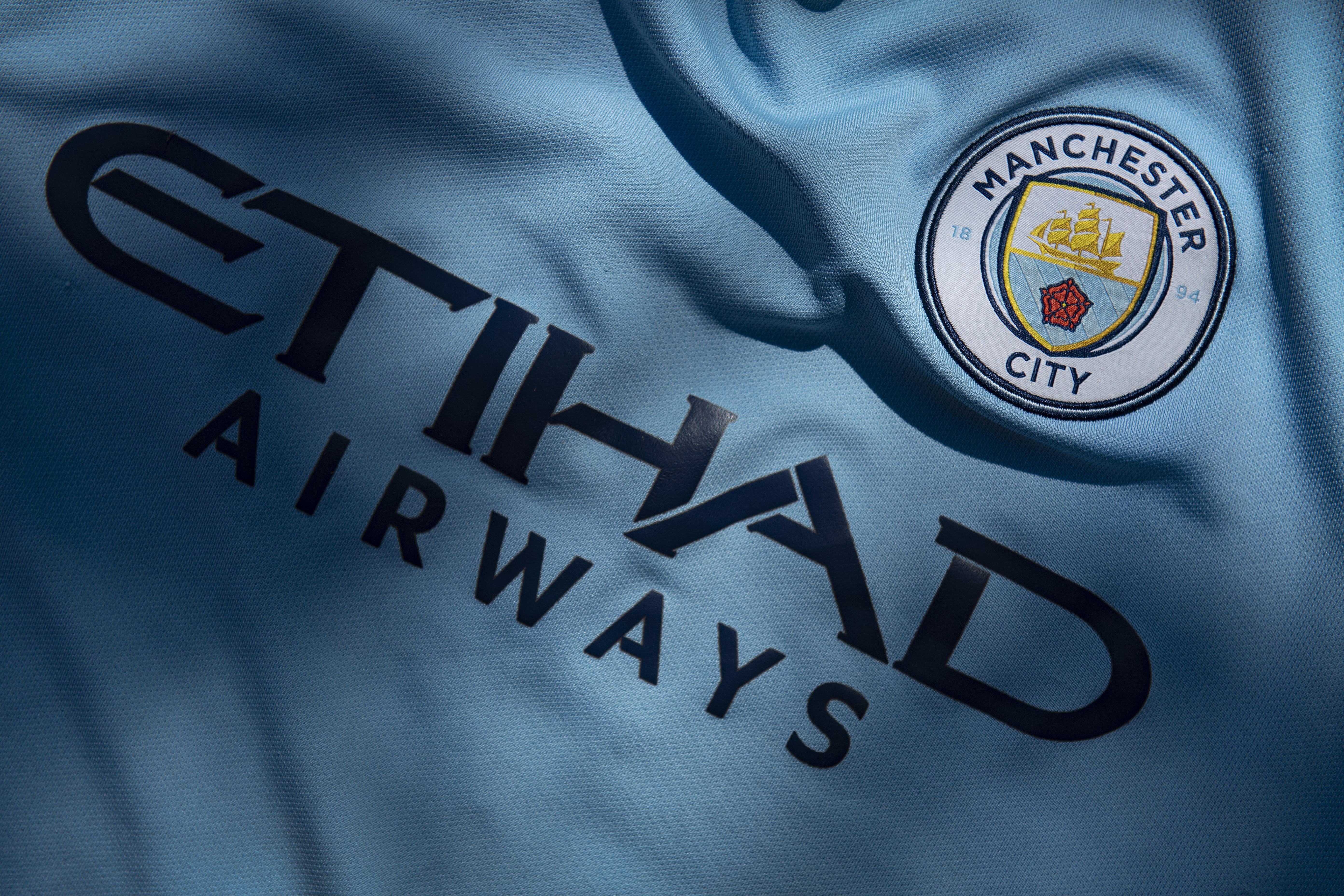 Manchester City Club Crest and Etihad Airways