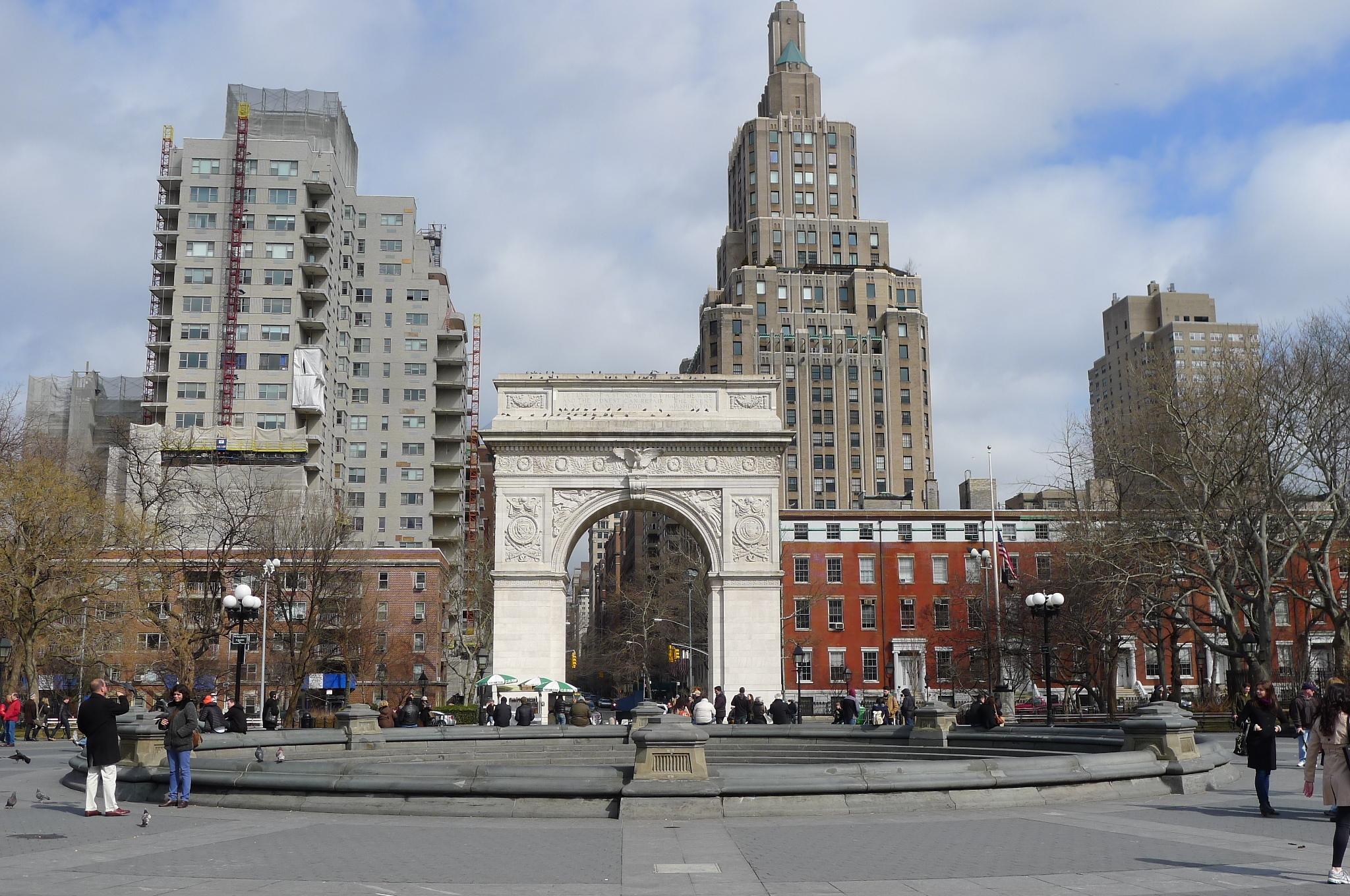 A white triumphal arch against the skyline.