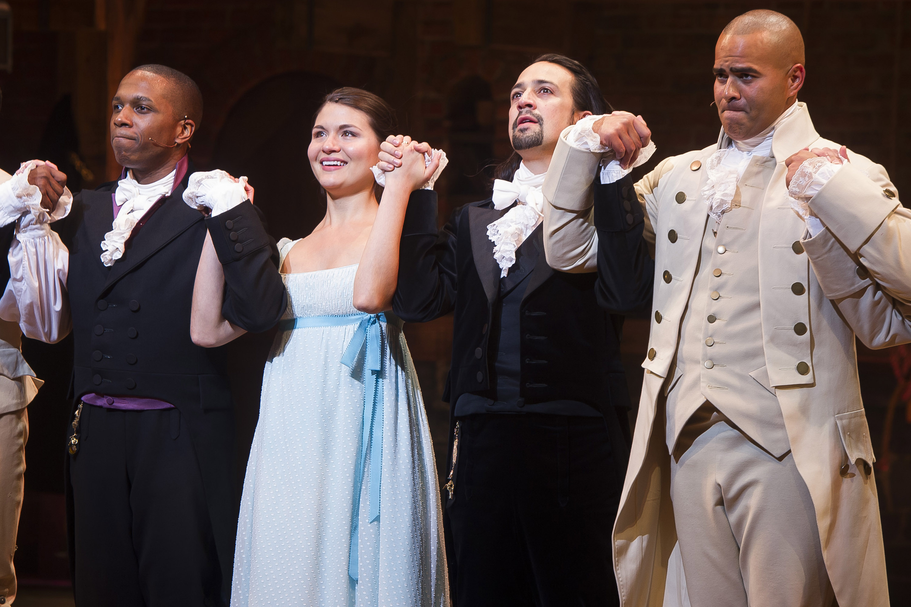 """20150806 In this Thursday, Aug. 6, 2015, file photo, Leslie Odom Jr., left, Phillipa Soo, Lin-Manuel Miranda and Christopher Jackson appear at the curtain call following the opening night performance of """"Hamilton"""" at the Richard Rodgers Theatre in New York. The production is still on Broadway, but much of the original cast members have left the show."""