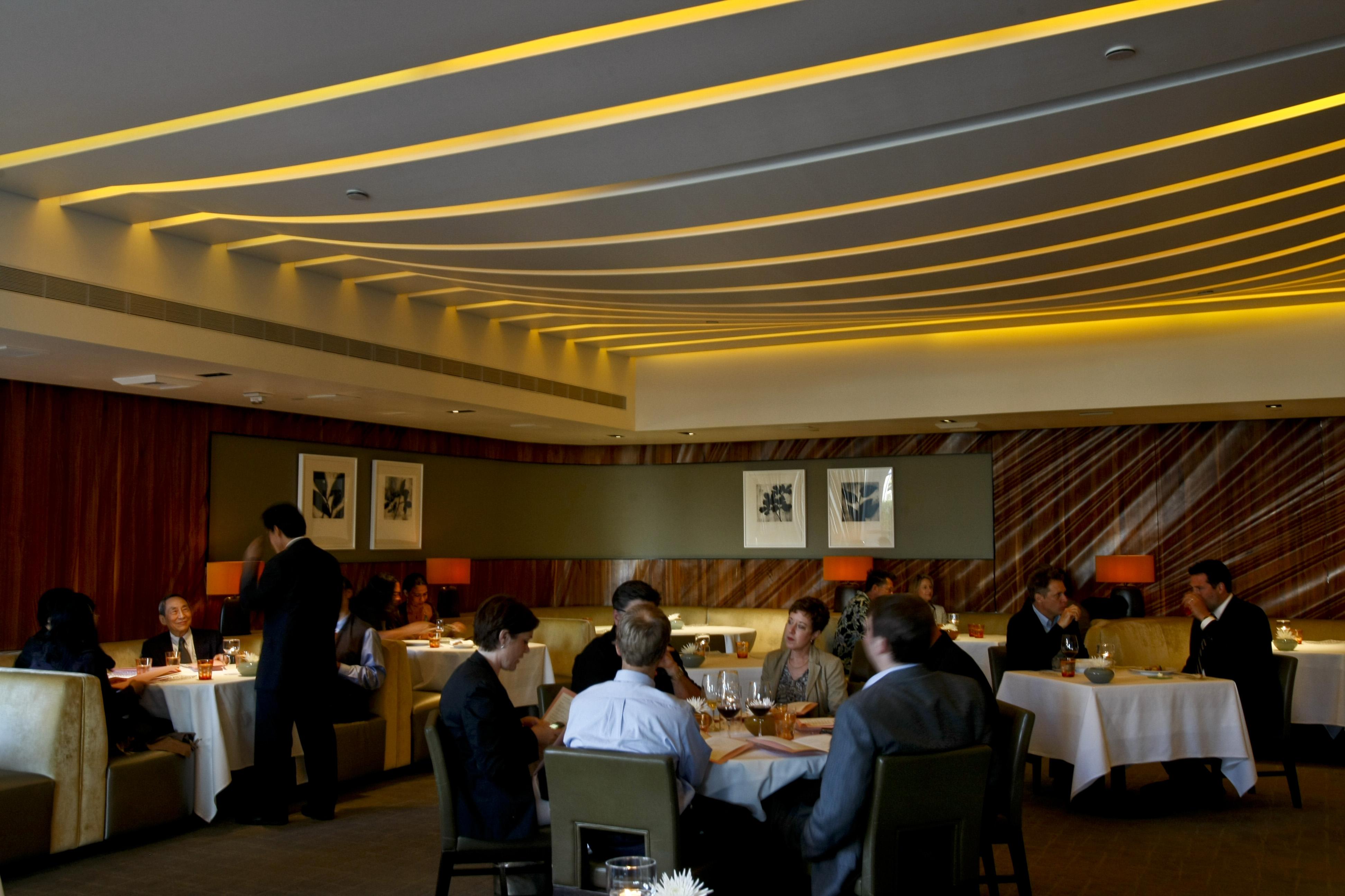 Diners enjoy dinner in the dinning room at Patina, an elegant restaurant at the Walt Disney Concert