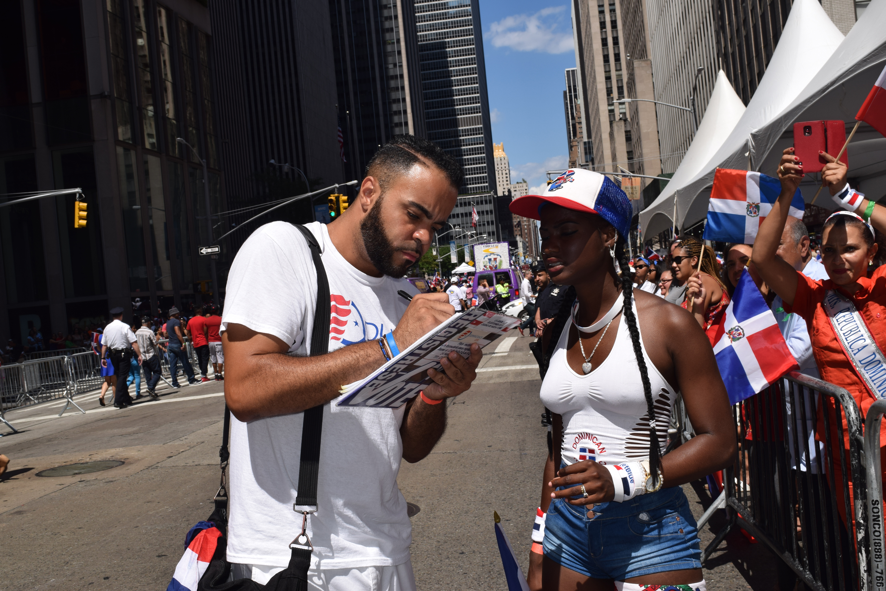 People register to vote during the 2019 Dominican Day Parade.