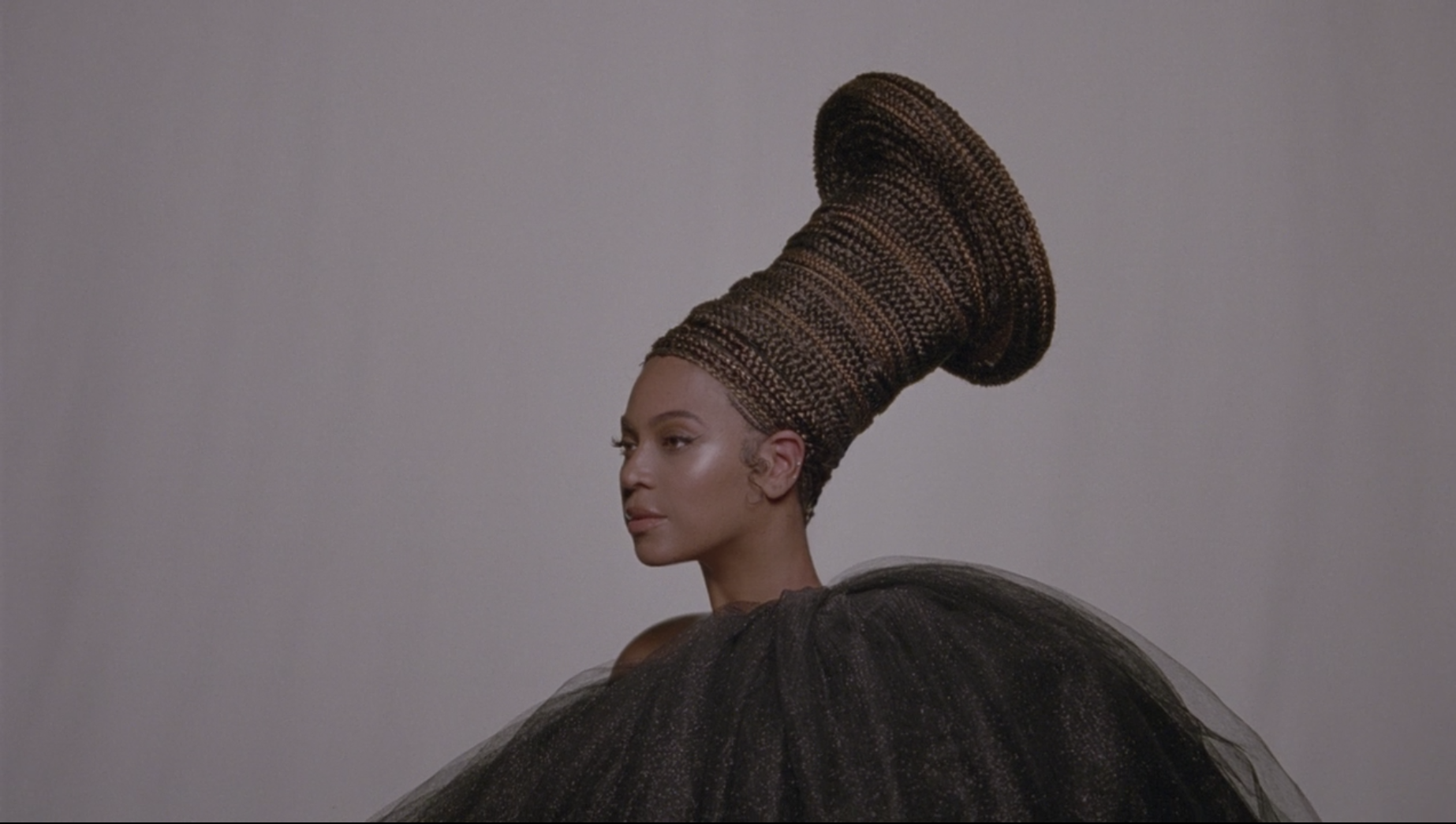 Beyonce in a headdress in Black is King.