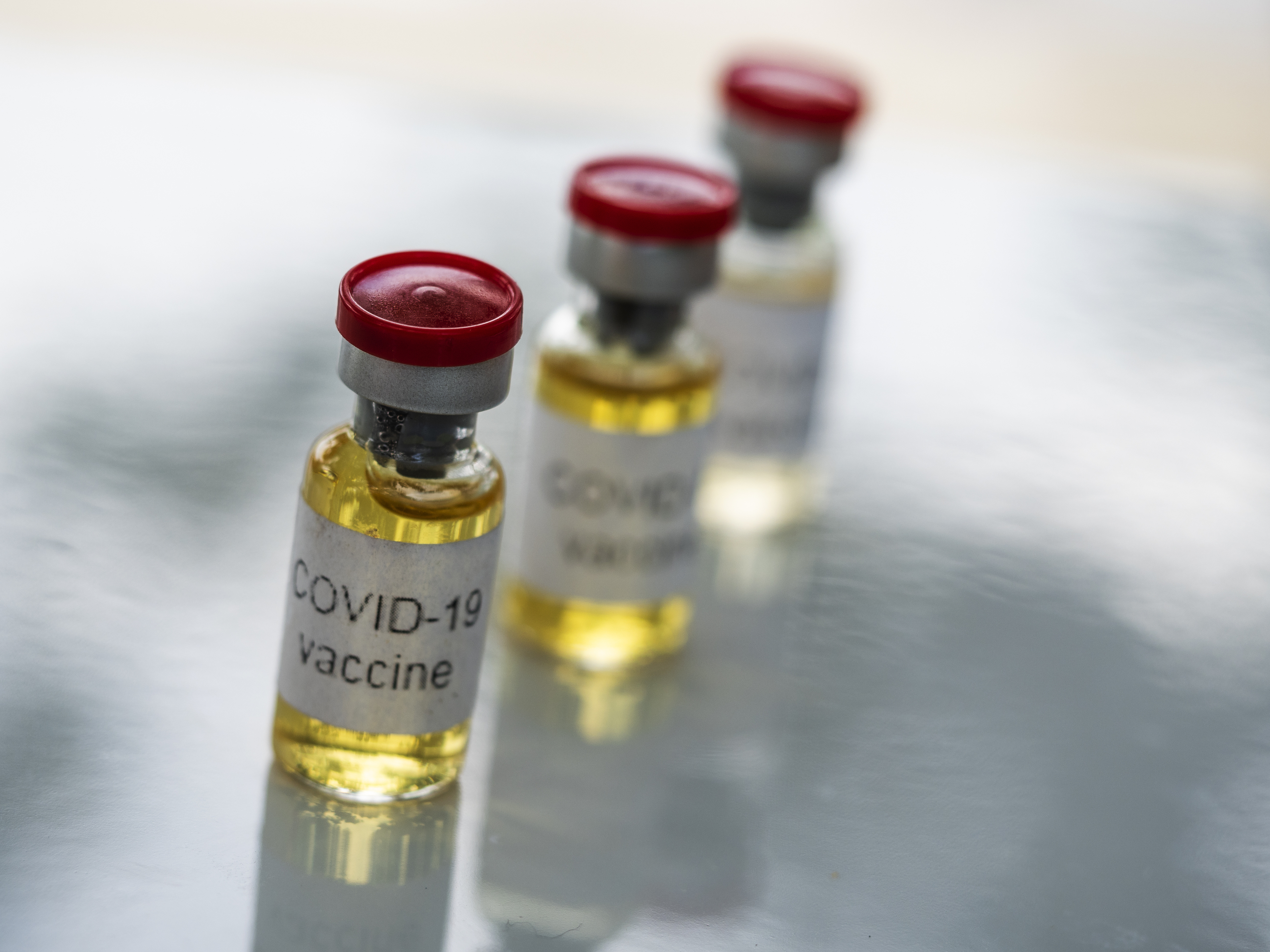 In this photo illustration, fake vials labelled 'Covid-19...