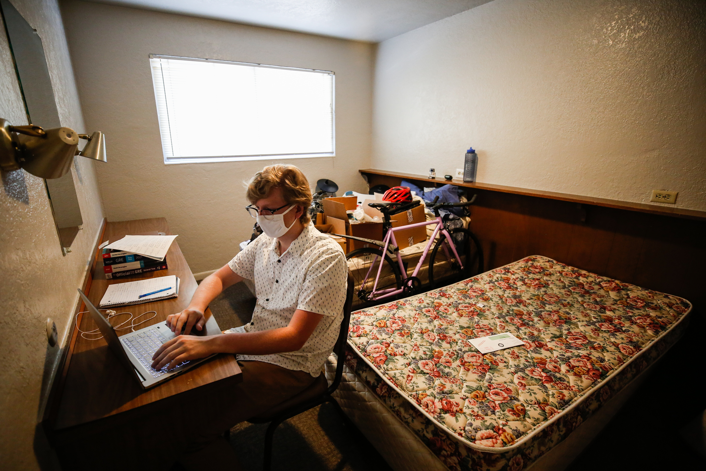 Jordan Hamann studies in an empty bedroom at his apartment in Provo on Monday, July 20, 2020.