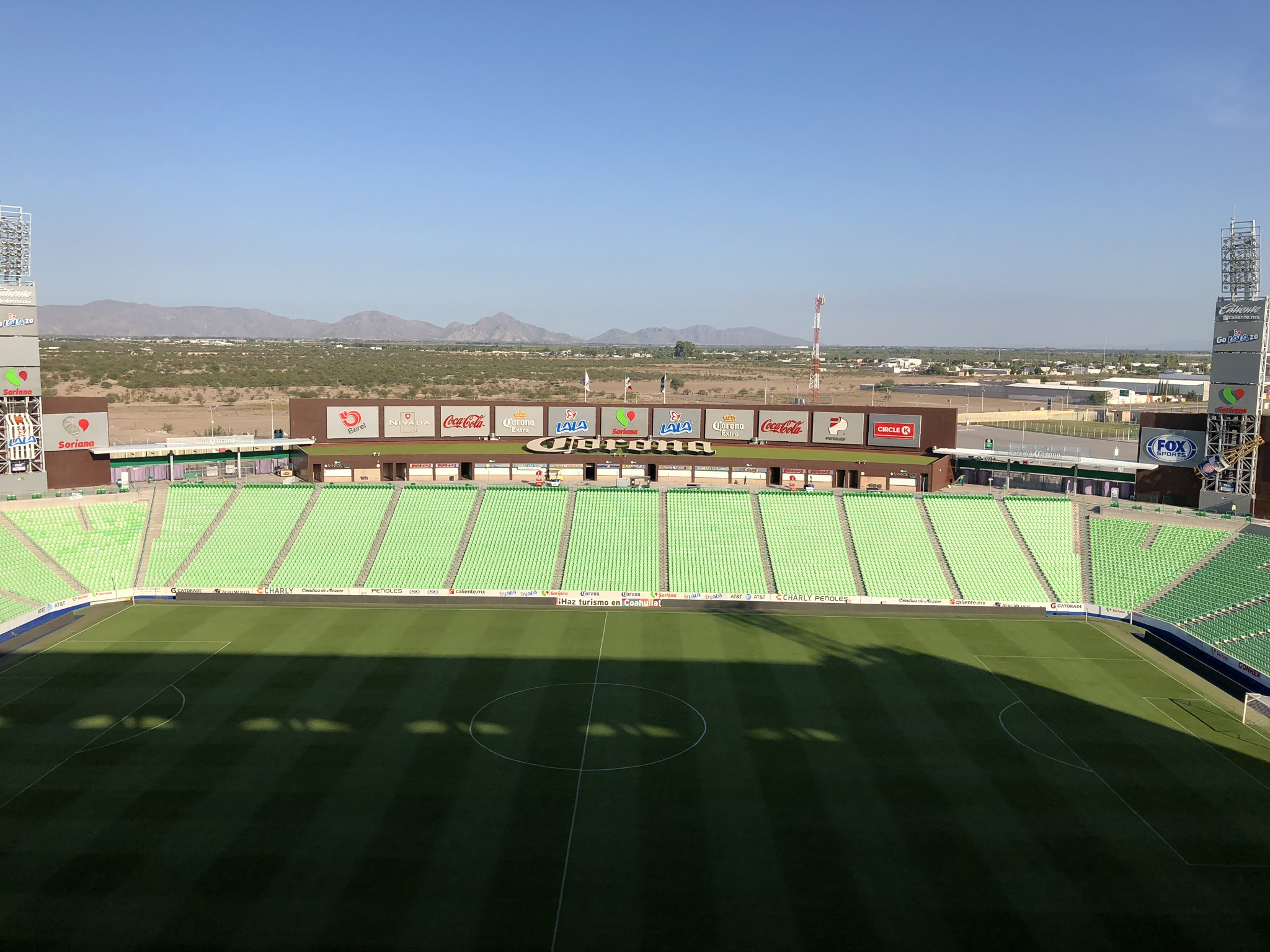 View of Estadio Corona with cerros (mountains) rising in the background.
