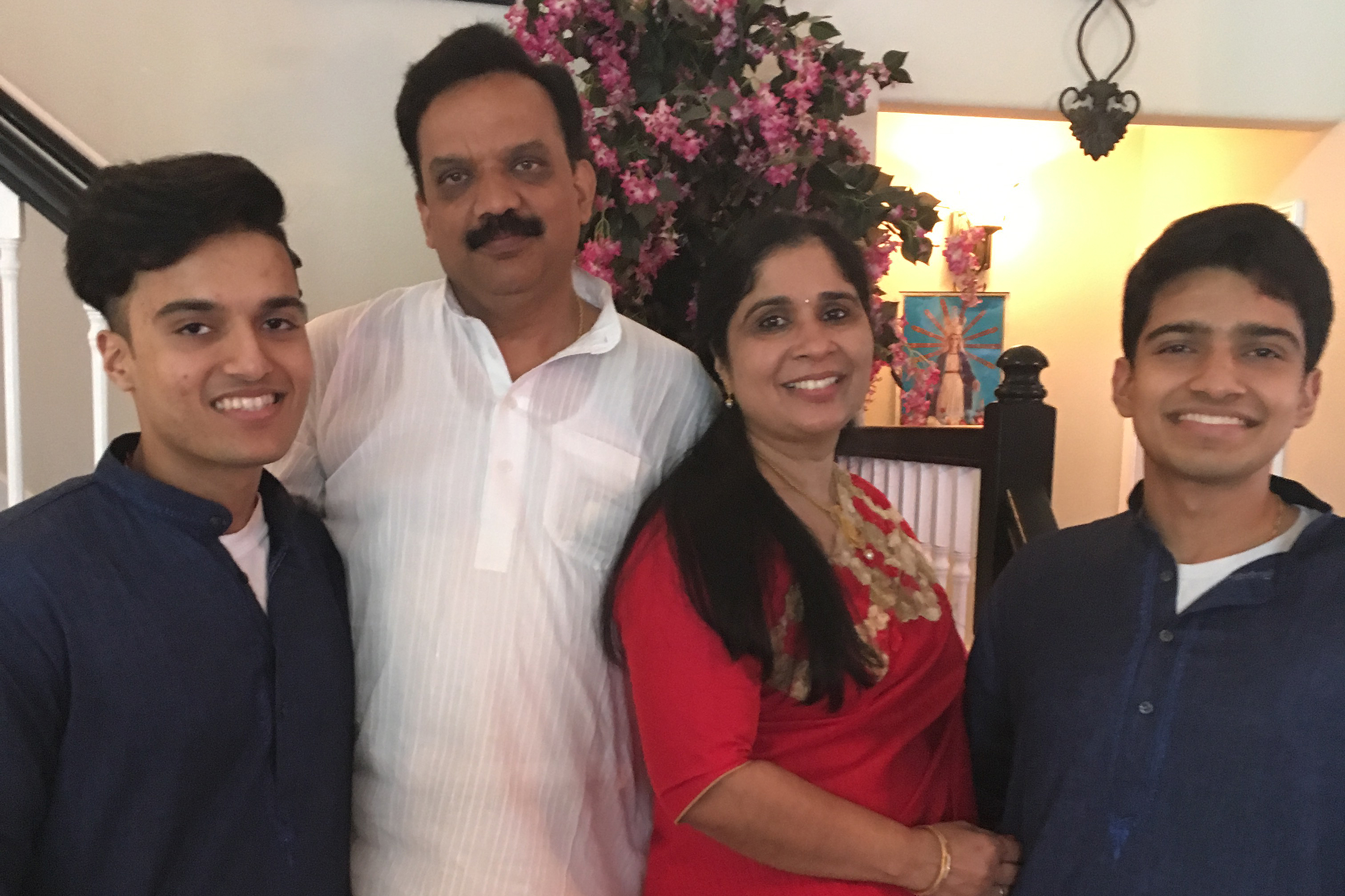 MTA worker Thankachan Mathai, pictured with his sons Cyril, left, and Mathews, and wife Sheeba. Thankachan died in April after contracting the coronavirus.