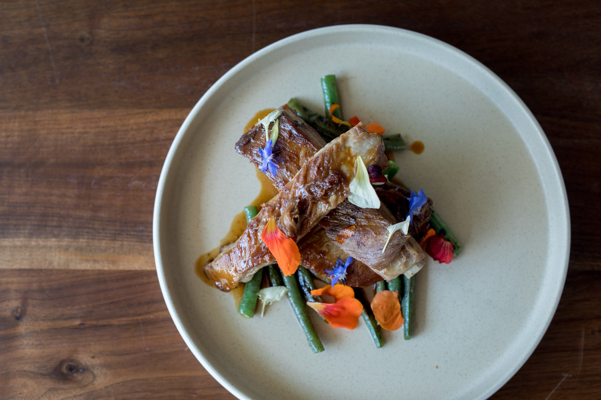 Magna chef Carlo Lamagna dresses up his father's adobo with edible flowers