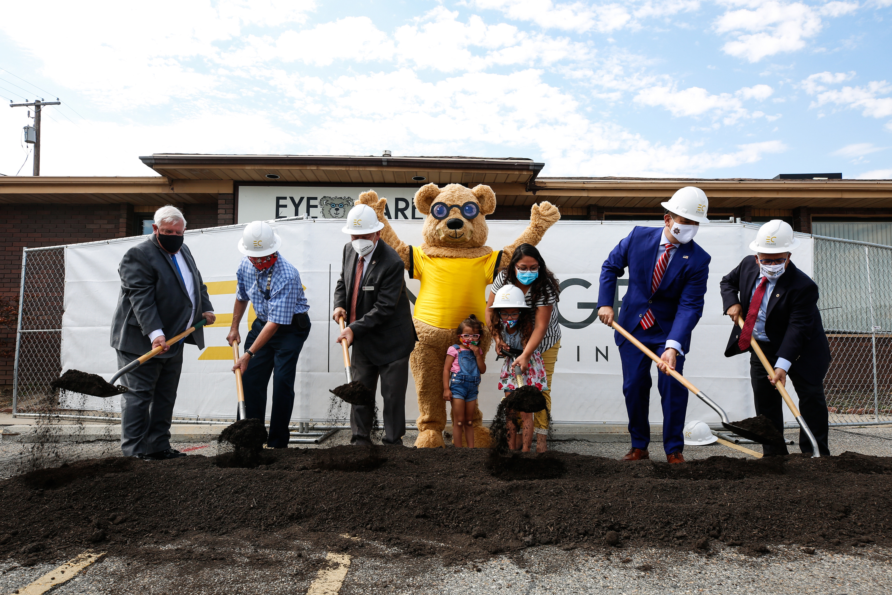 Dignitaries shovel soil during a groundbreaking ceremony for an Eye Care 4 Kids clinic in Midvale on Monday, Aug. 3, 2020.