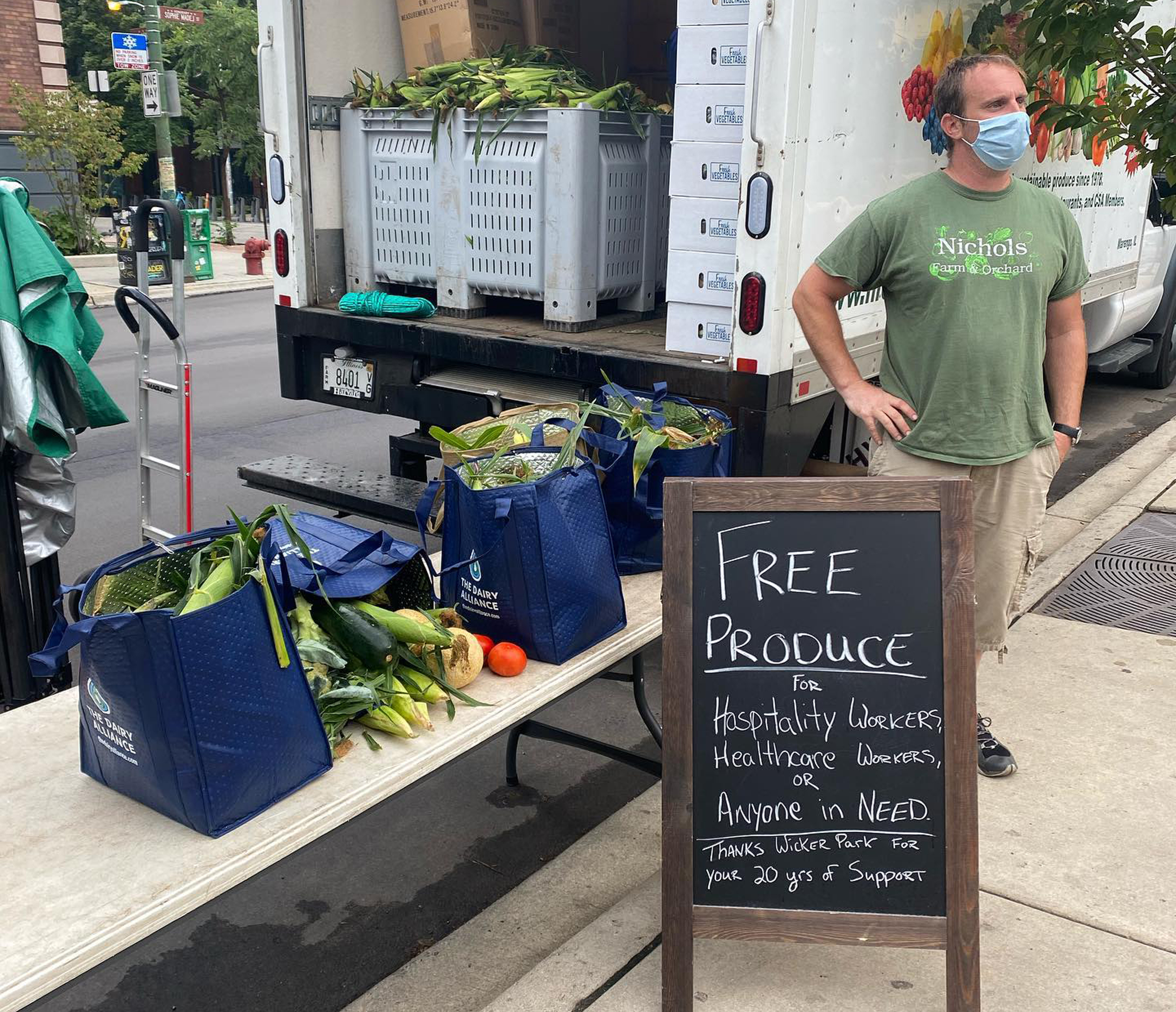 After Nichols Farm and Orchard was told July 28 they no longer could sell at the Wicker Park Farmers Market, Nick Nichols showed up anyway on Sunday, Aug. 2, 2020. He parked next to the market and gave away a truckload of produce. The neighborhood chamber of commerce said Nichols' stand was removed due to violations of COVID-19 protocol.