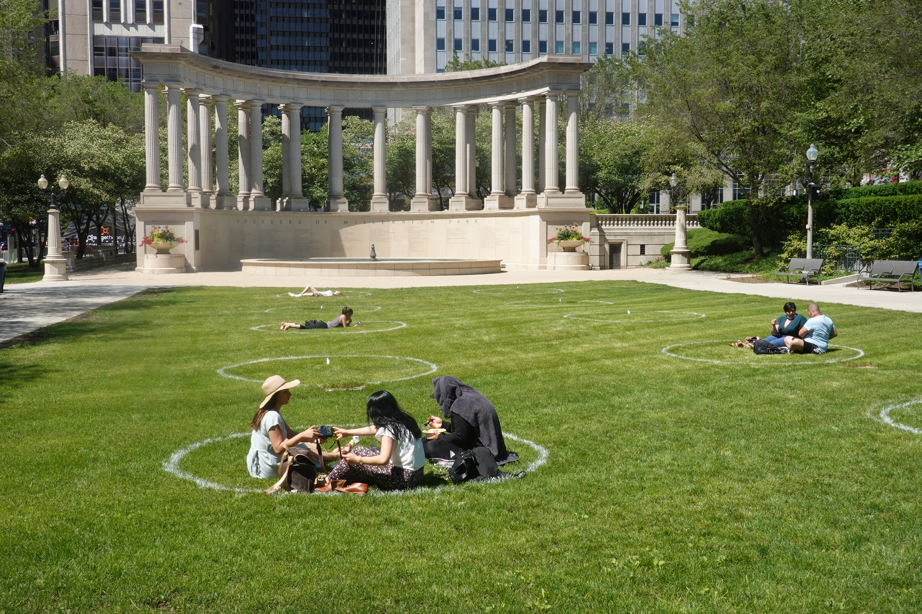 People sitting inside circles in Millennium Park