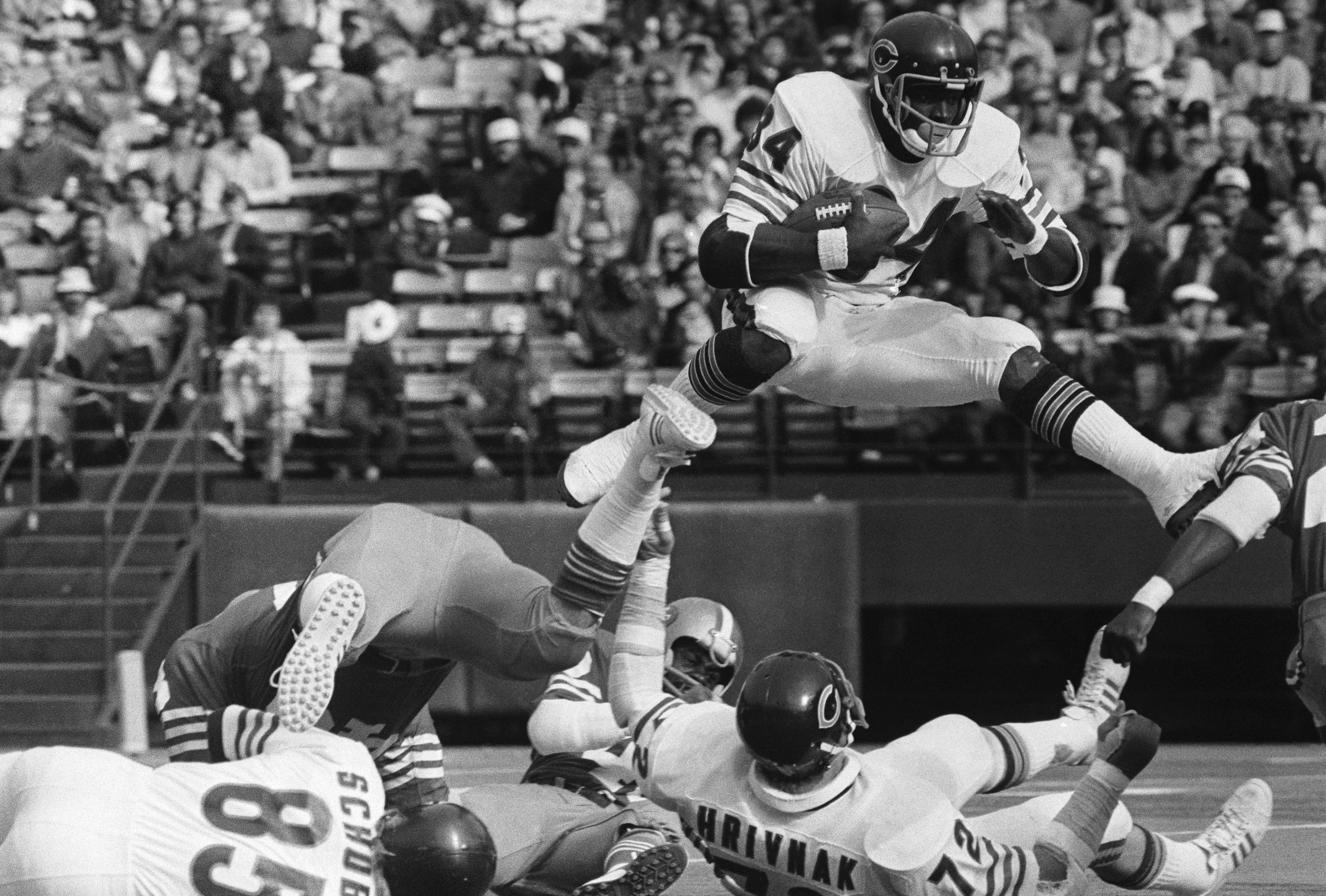 Walter Payton Jumps Over Gary Hrivnak in Game