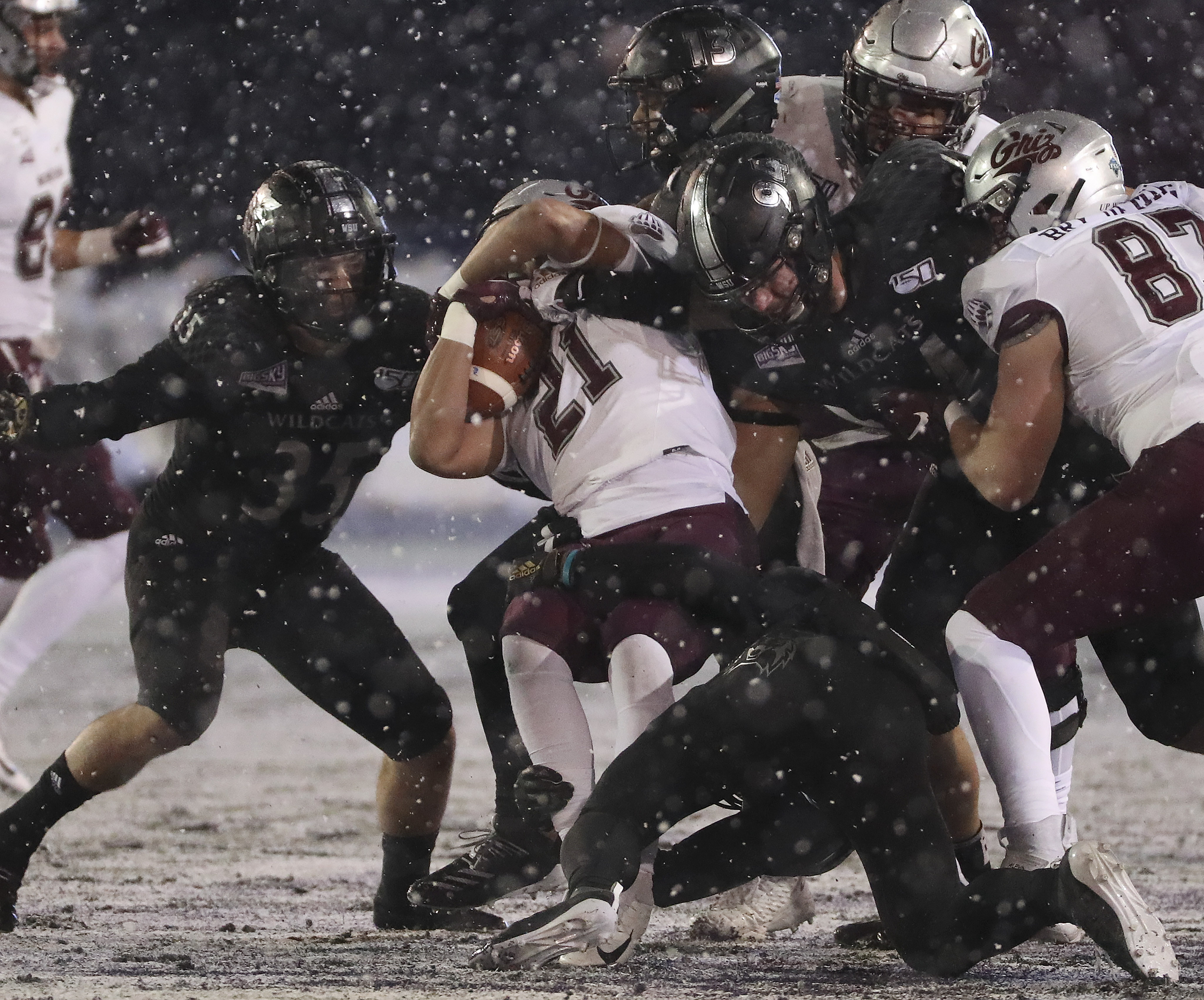 Weber State Wildcats defense tackle Montana Grizzlies running back Marcus Knight (21) during the FCS quarterfinals at Stewart Stadium in Ogden on Friday, Dec. 13, 2019.