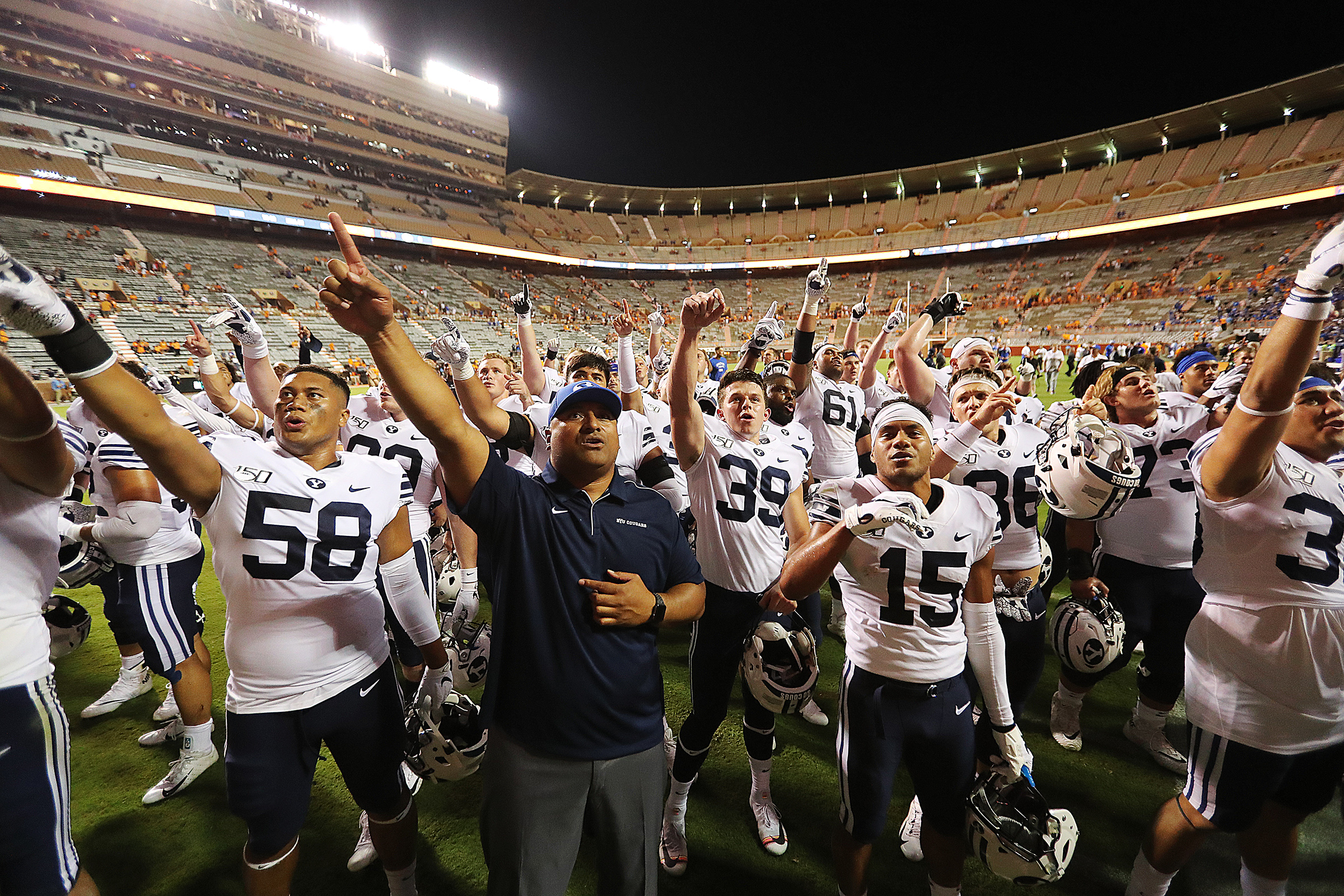 Head coach Kalani Sitake and his players sing to the fans high up in the upper deck as they celebrate their win over Tennessee in Knoxville on Saturday, Sept. 7, 2019. BYU won 29-26 in double overtime.