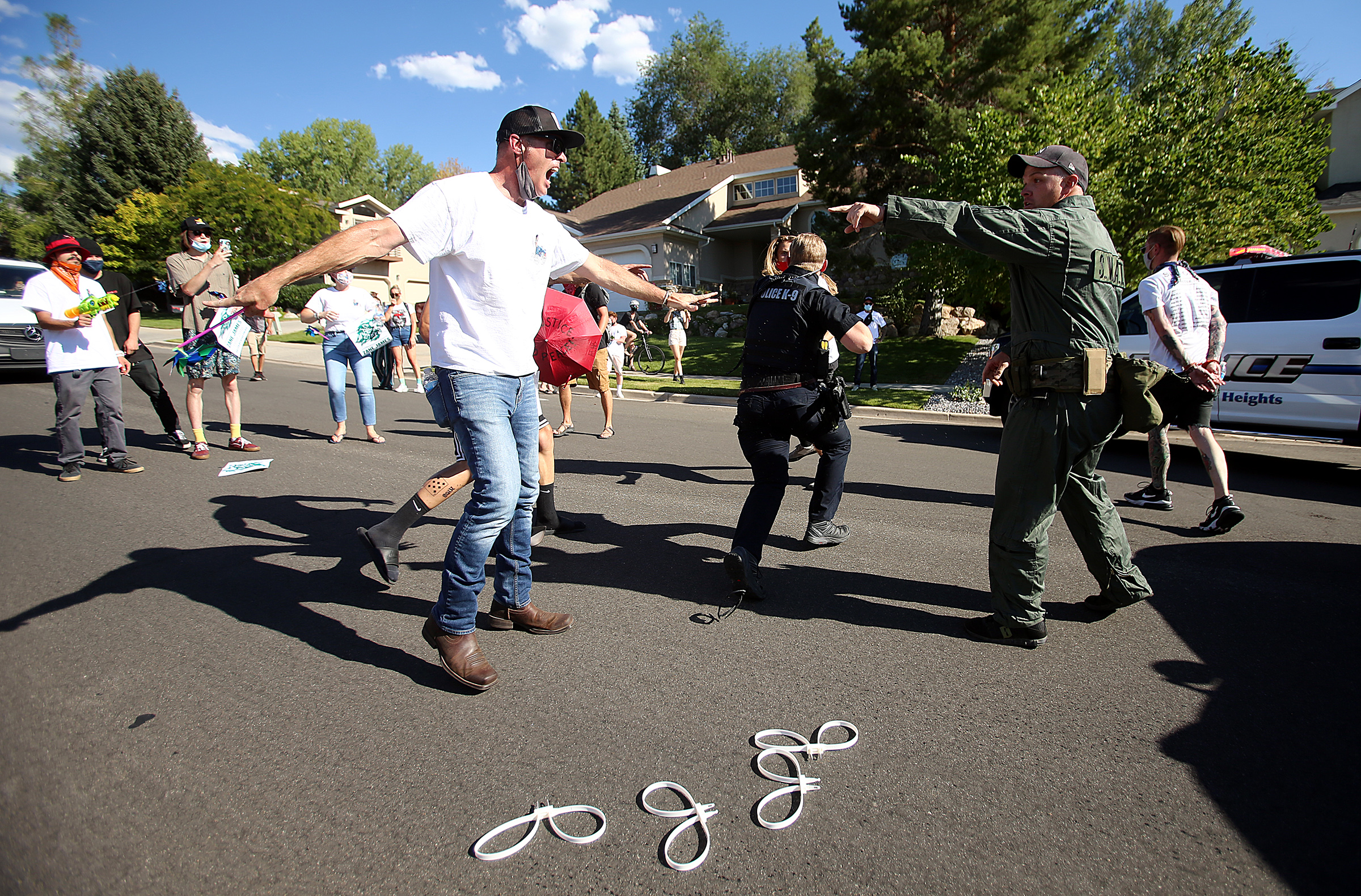 Aaron James, father of Zane James, yells at a police officer as protesters and police clash in the streets of Cottonwood Heights on Sunday, Aug. 2, 2020. The group wasmarching on 6710 South,down the street from where the 19-year-old Zane James was shot and killed by Cottonwood Heights police in 2018 after allegedly robbing two stores,when police blocked them at Cristobal Street and a confrontation ensued. Multiple marchers, including Aaron James, were arrested.