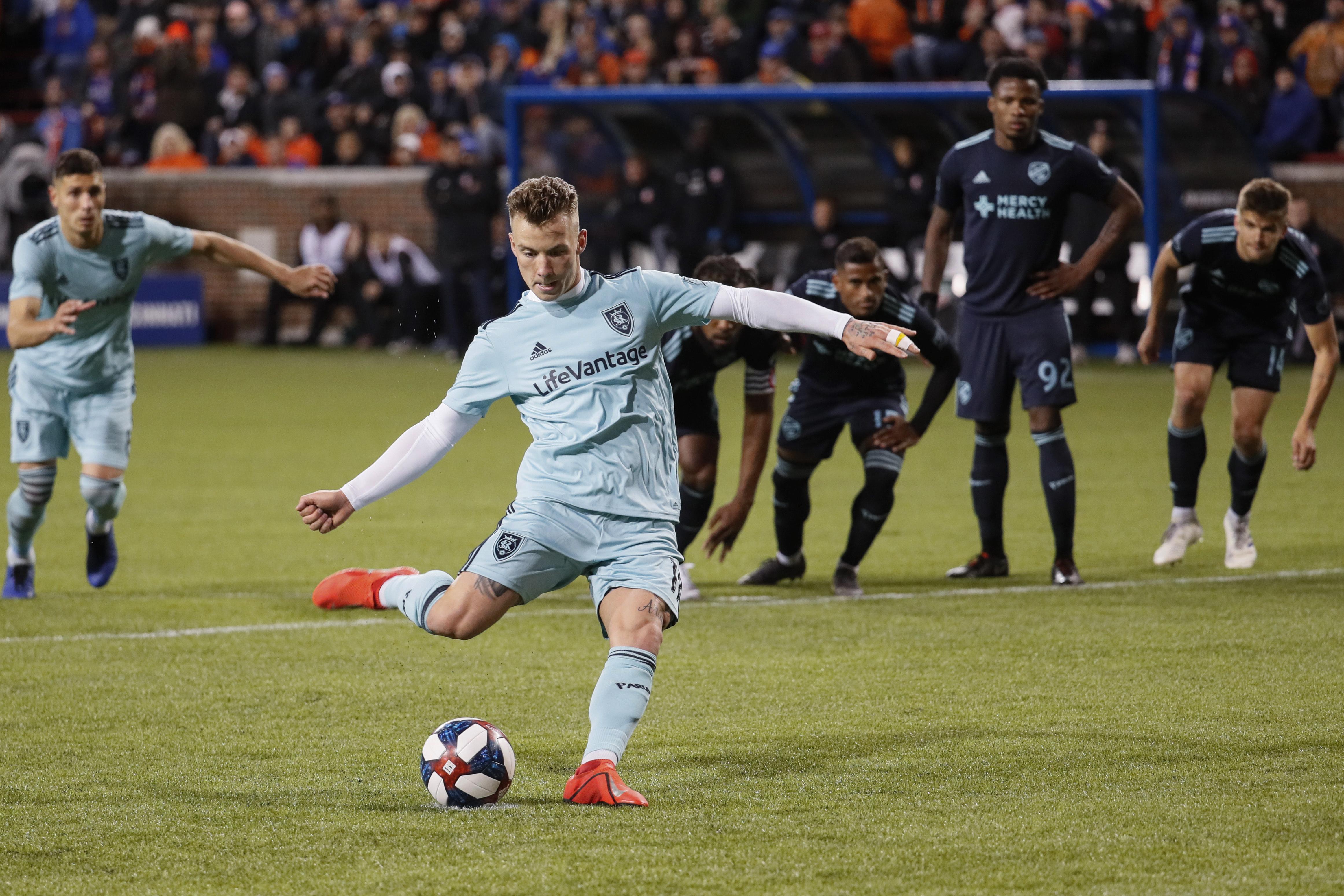 Real Salt Lake midfielder Albert Rusnak takes a penalty kick during the second half of the team's MLS soccer match against FC Cincinnati, Friday, April 19, 2019, in Cincinnati. (AP Photo/John Minchillo)