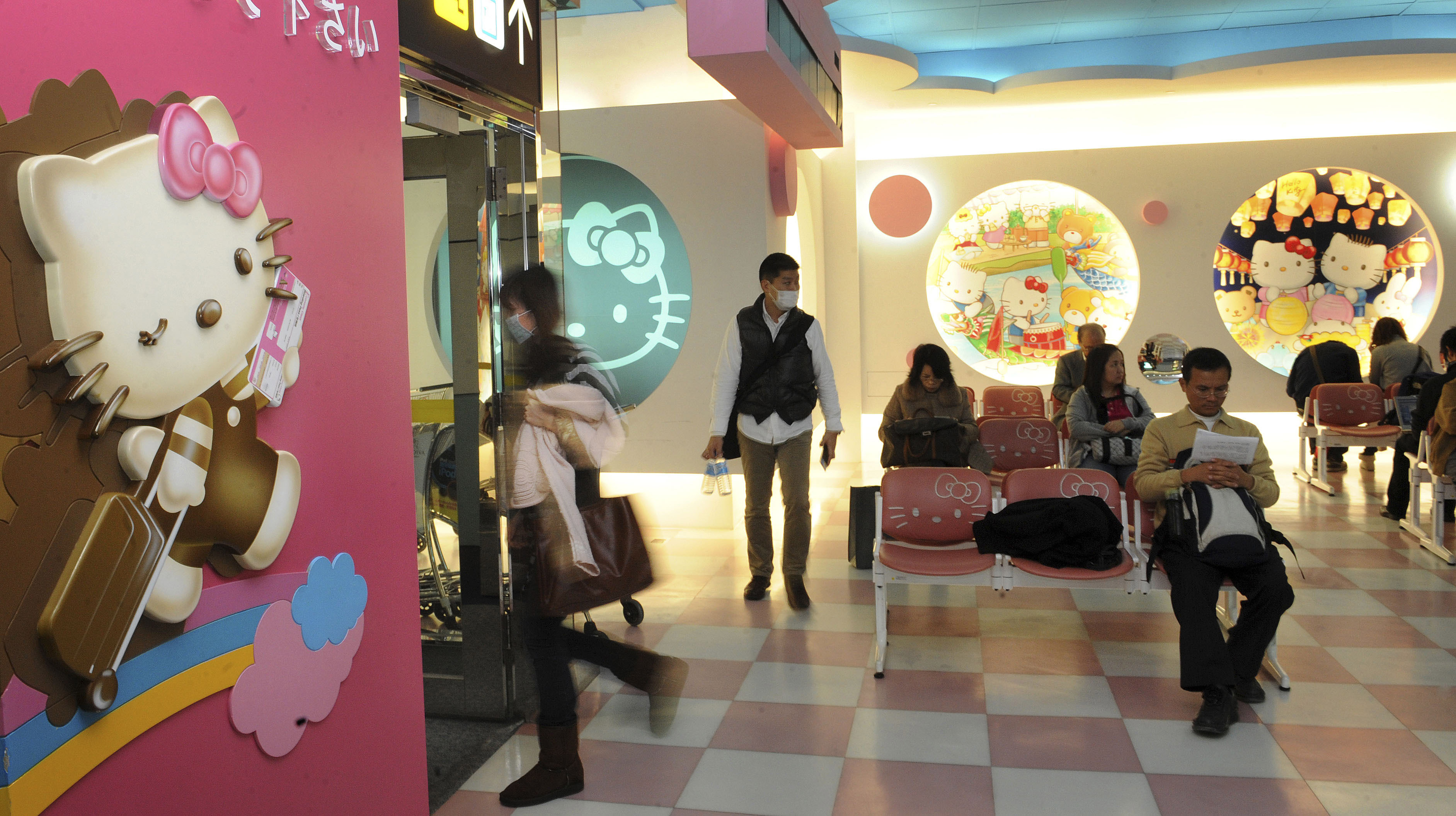 "In this photo taken Friday, Dec. 25, 2009, air passengers wait in the Japanese feline character ""Hello Kitty"" designed terminal gate at the Taipei International Airport, in Taoyuan, Taiwan. Taiwanese airline EVA Air his hosting a special Father's Day flight on its Hello Kitty-themed airplane."