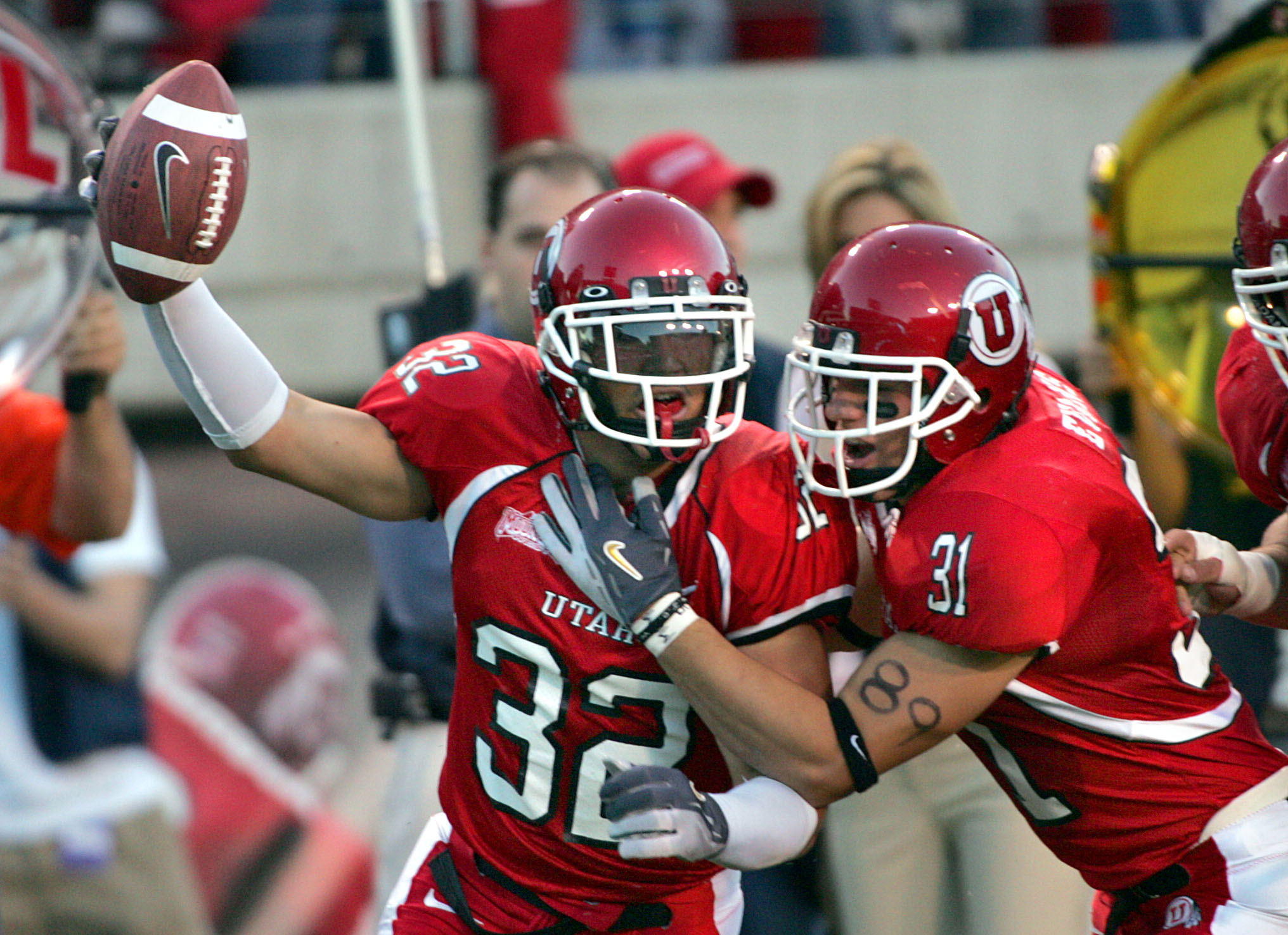 Utah's Eric Weddle left, and Casey Evans celebrate after Weddle recovered a fumble againsit Air Force Academy Sept. 22, 2005.