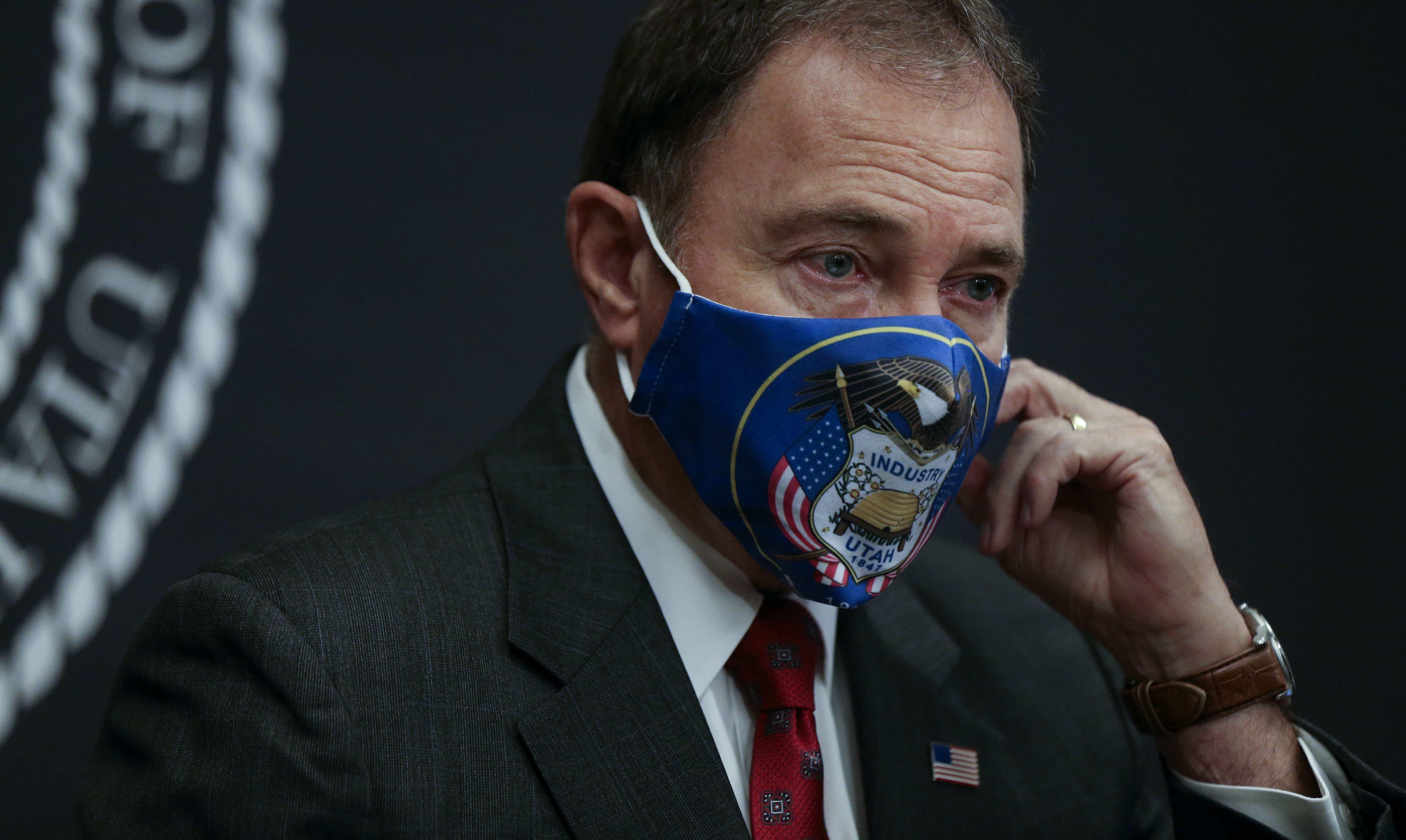 Gov. Gary Herbert removes a face mask before speaking at a COVID-19 briefing at the Capitol in Salt Lake City on Thursday, July 30, 2020.