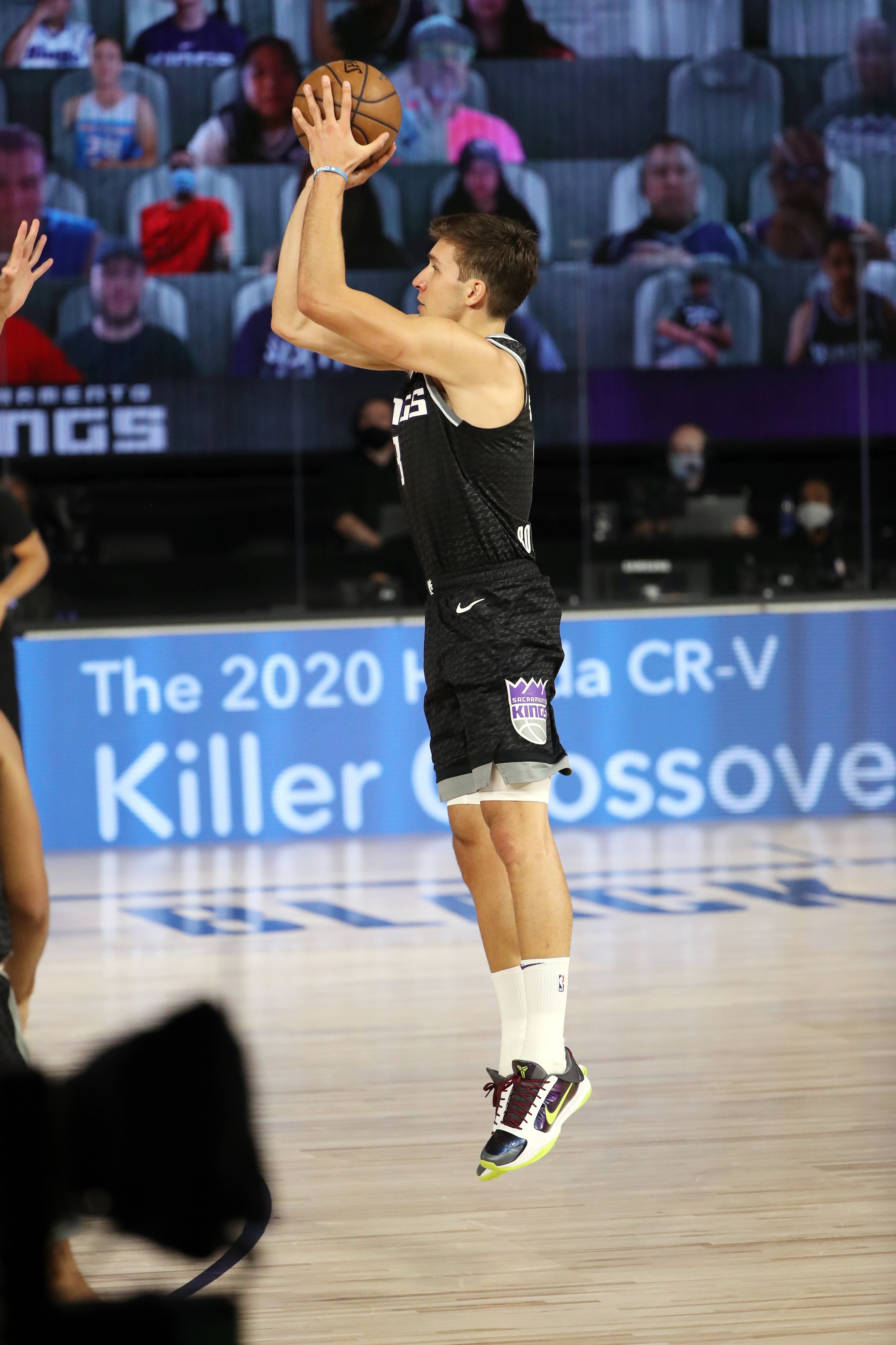 Bogdan Bogdanovic of the Sacramento Kings shoots a three point basket during the game against the New Orleans Pelicans on August 6, 2020 at The HP Field House at ESPN Wide World Of Sports Complex in Orlando, Florida.