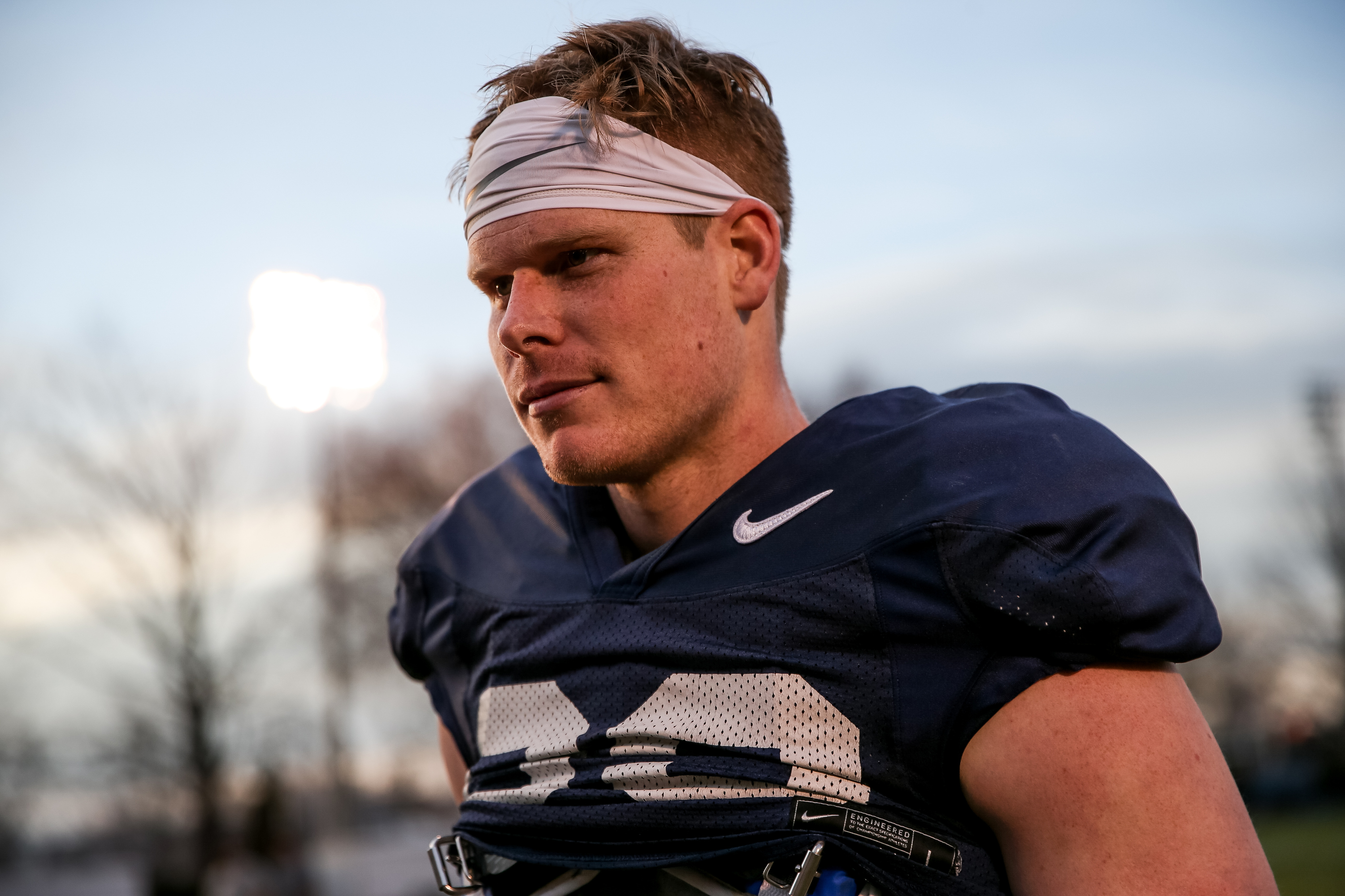 Tight end Matt Bushman walks off the field after a Brigham Young University football practice in Provo on Friday, March 6, 2020.