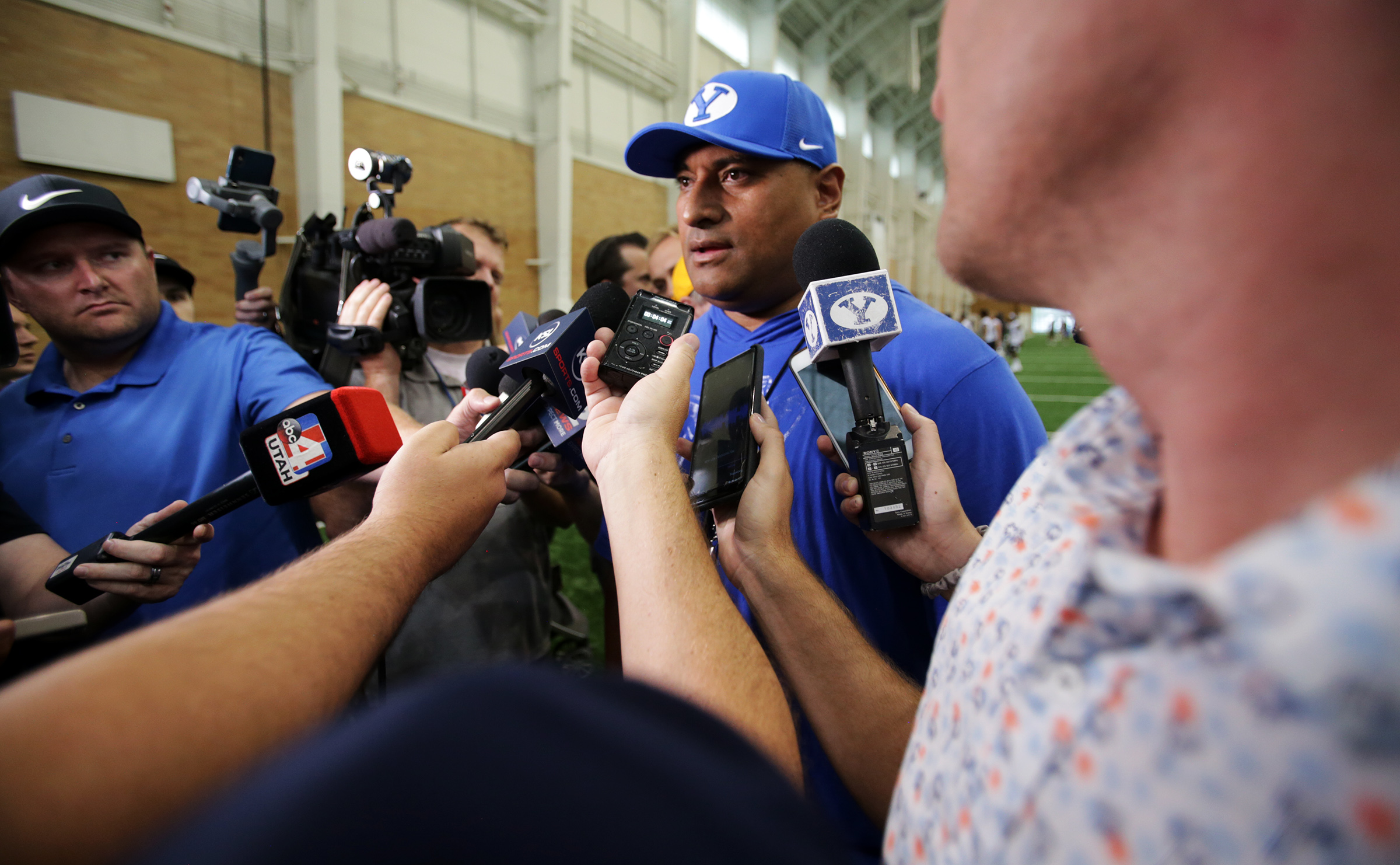 Head football coach Kalani Sitake talks with members of the media after BYU opened football practice at the indoor facility in Provo on Wednesday, July 31, 2019.