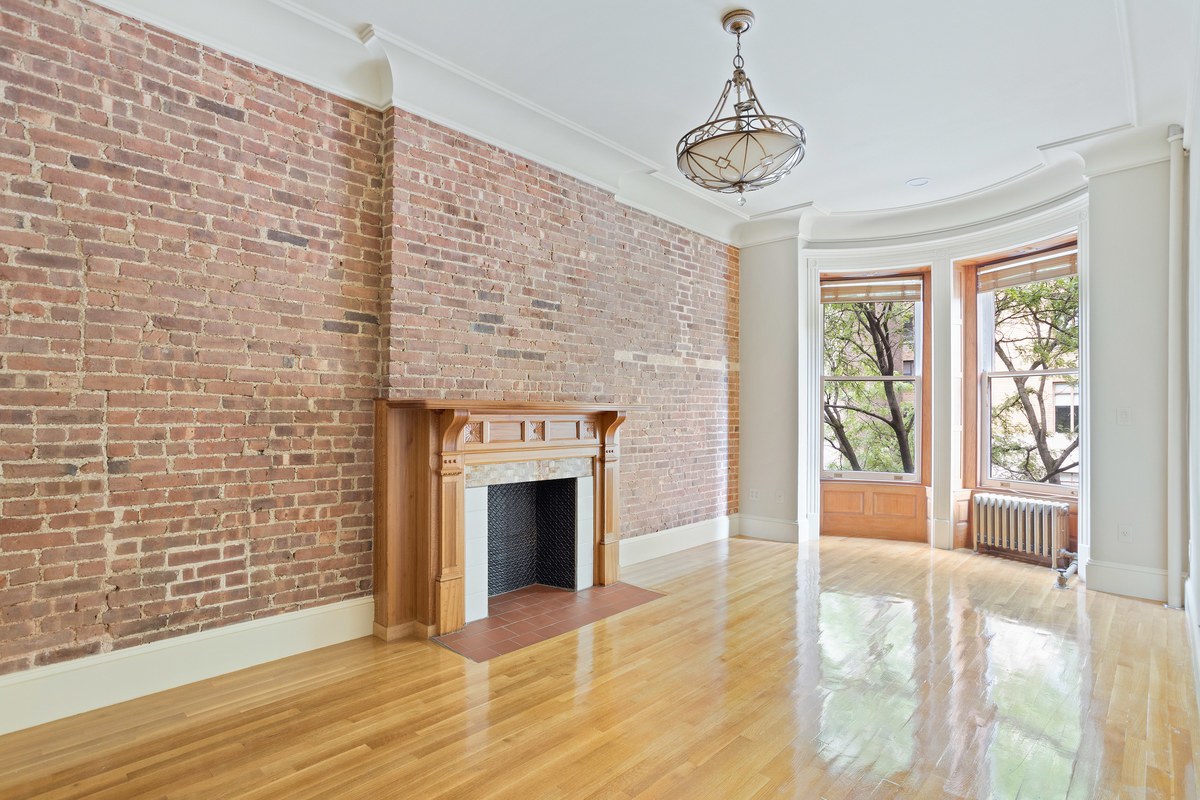Bright living room with exposed brick.