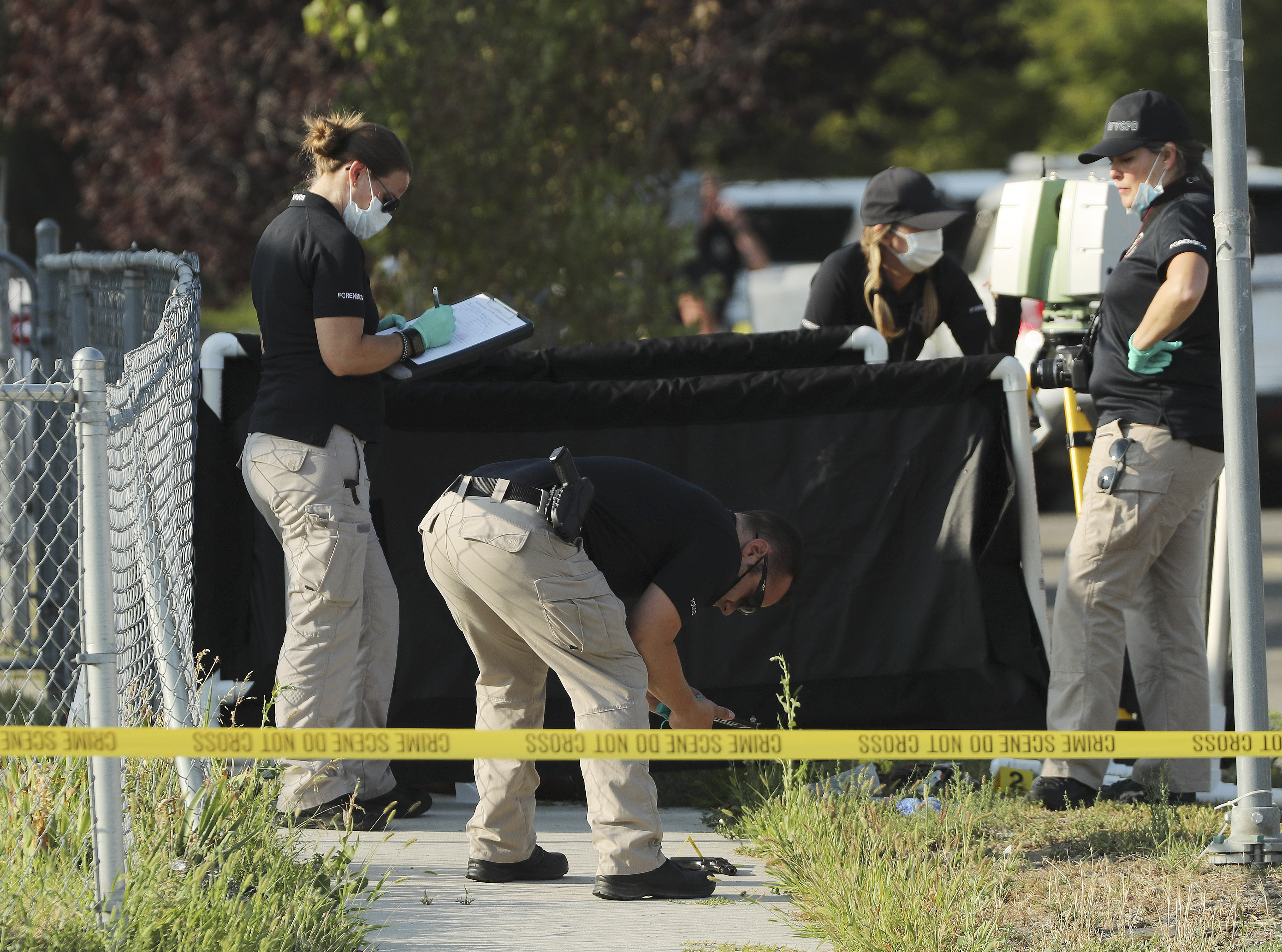 Police investigate an officer involved shooting at 5400 S 5400 W. in Kearns on Tuesday, Aug. 4, 2020.