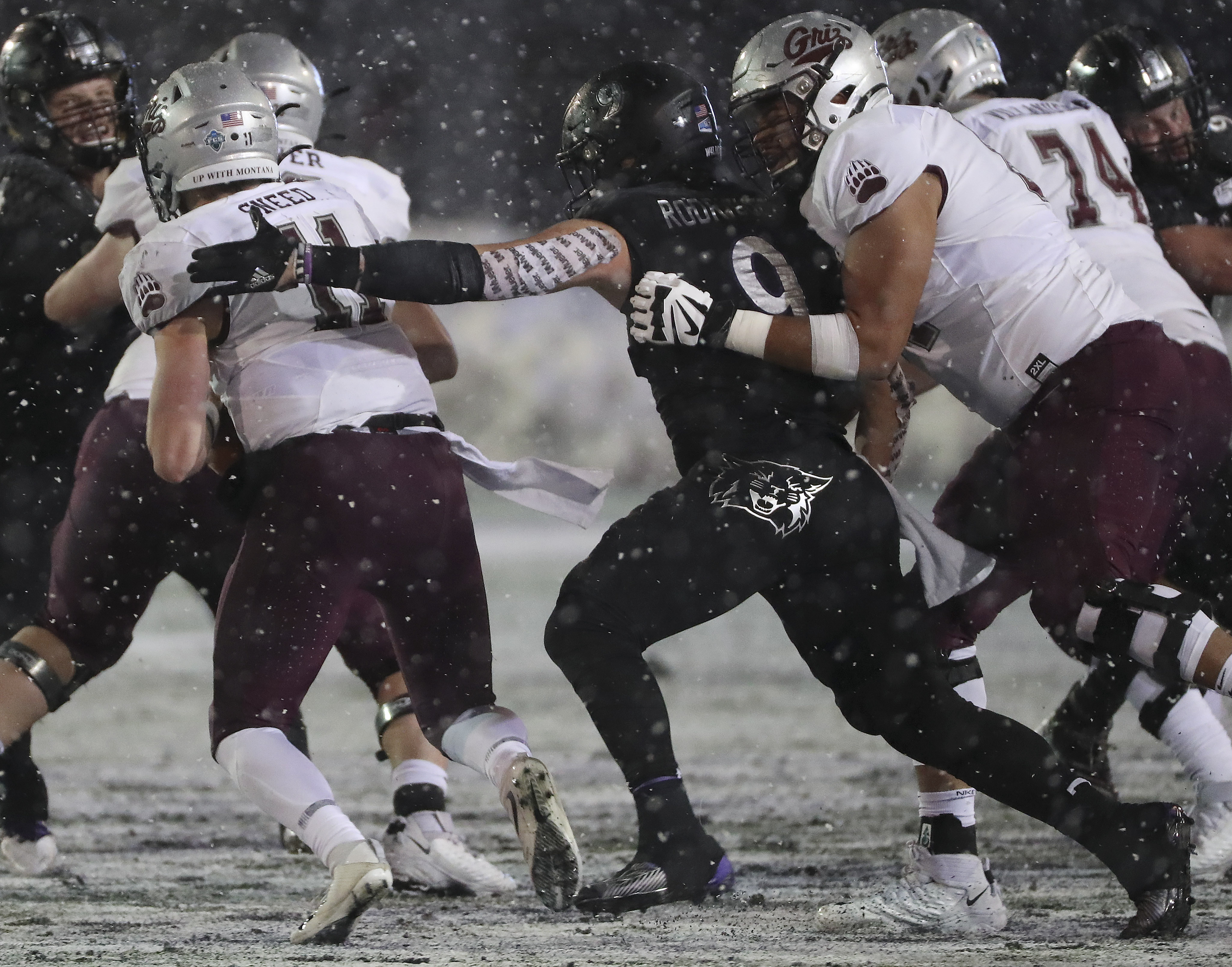 Weber State Wildcats defensive end Adam Rodriguez (9) sacks Montana Grizzlies quarterback Dalton Sneed (11) during the FCS quarterfinals at Stewart Stadium in Ogden on Friday, Dec. 13, 2019.
