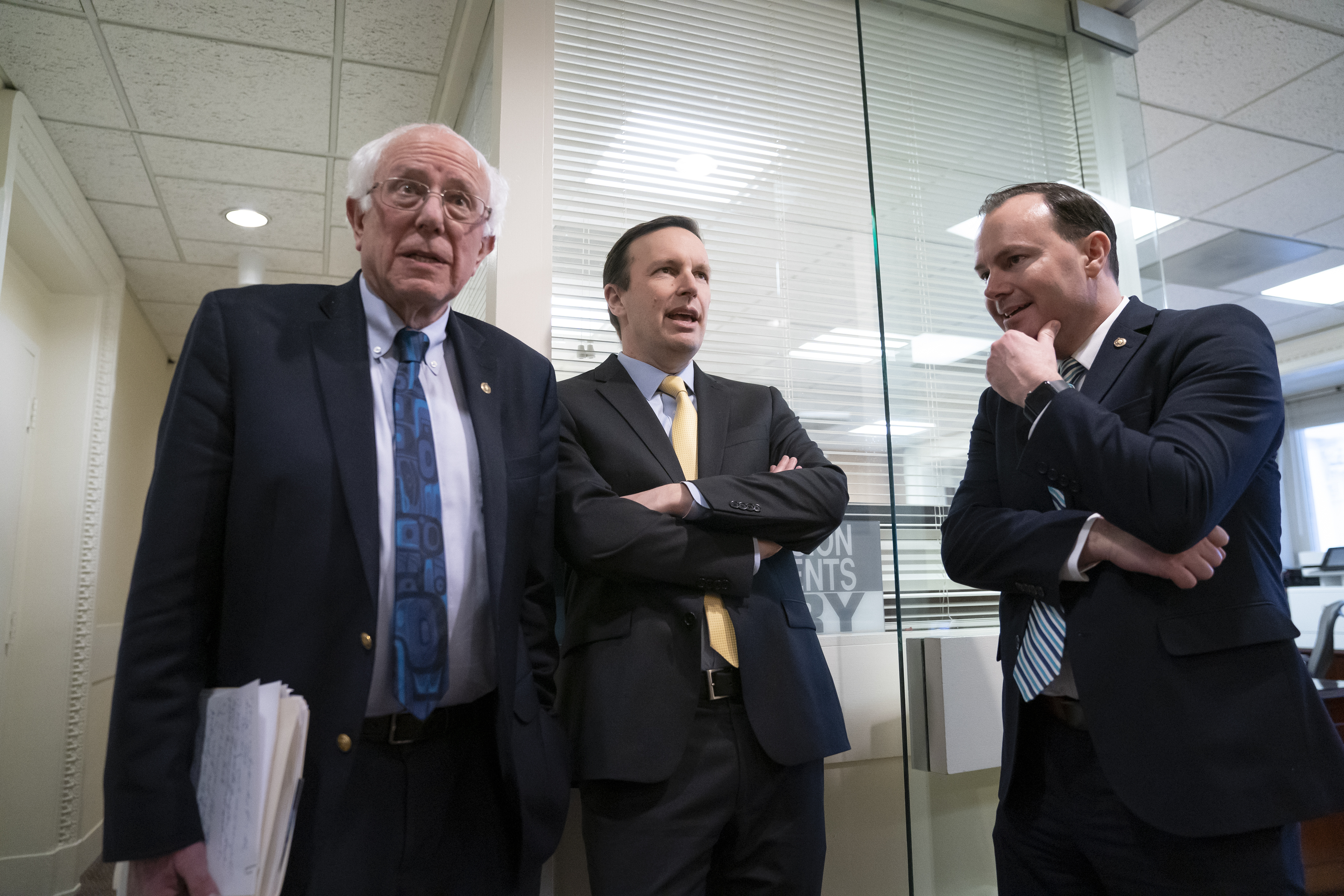 From left, Sen. Bernie Sanders, I-Vt., Sen. Chris Murphy, D-Conn., and Sen. Mike Lee, R-Utah, meet before holding a news conference at the Capitol in Washington, Wednesday, March 13, 2019. The three senators, along with Sen Chris Coons, D-Del., and Sen. Rand Paul, R-Ky., have introduced legislation that would amend the Arms Export Control Act to prohibit the export of certain weaponized unmanned aircraft systems.