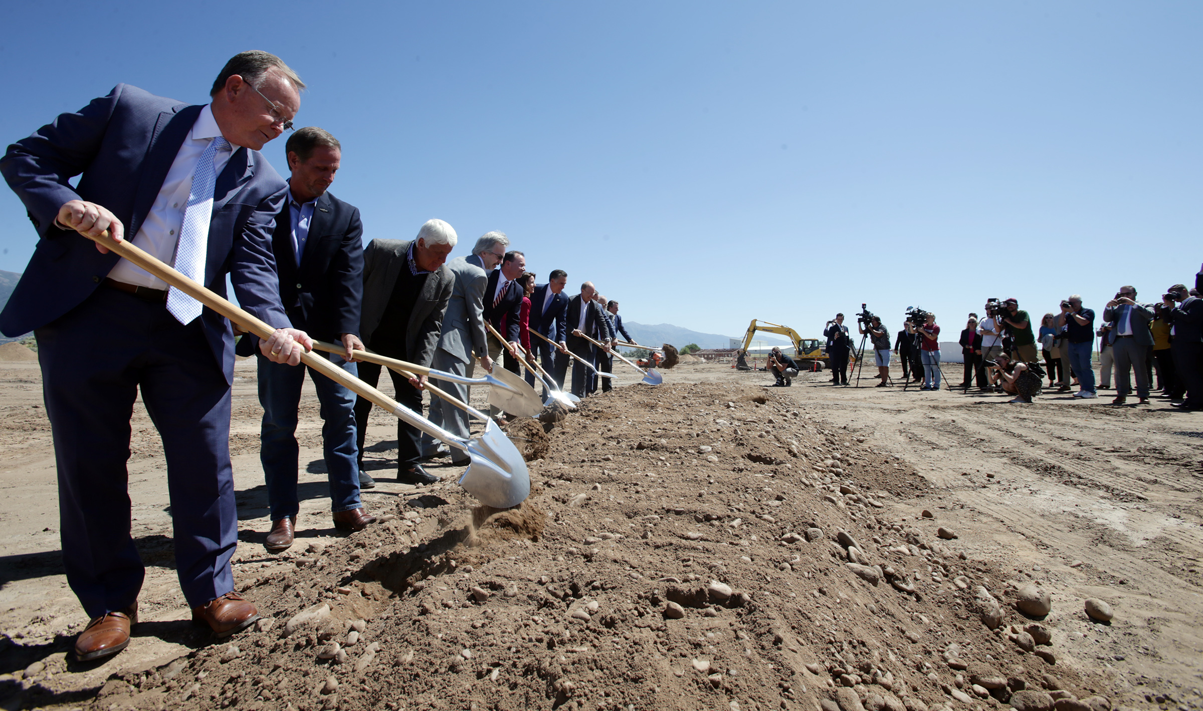 Officials uses shovels to symbolically break ground as Northrop Grumman begins work on a missile defense development facility in Roy on Tuesday, Aug. 27, 2019.