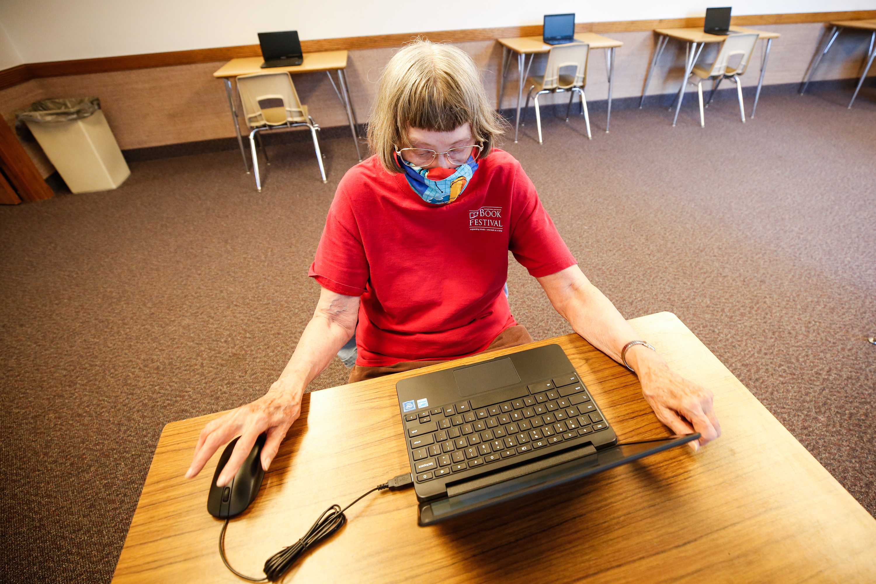 Allene Dotson surfs the internet on a laptop at Rose Park Stake Center of The Church of Jesus Christ of Latter-day Saints in Salt Lake City on Thursday, Aug. 6, 2020. It is part of a program for people in the community who don't have internet access in their home.