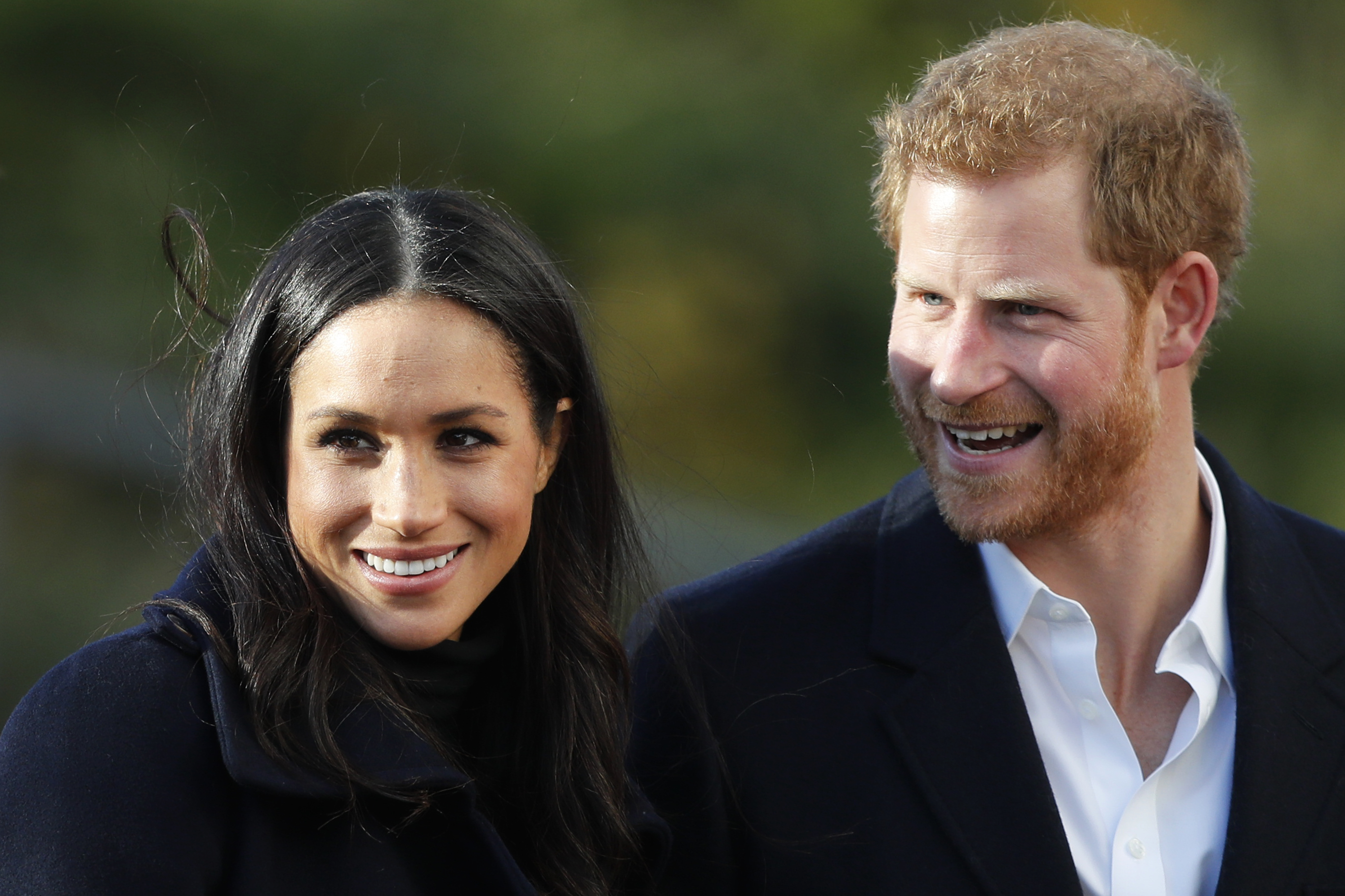 In this Dec. 1, 2017 file photo, Britain's Prince Harry and his fiancee Meghan Markle arrive at Nottingham Academy in Nottingham, England.