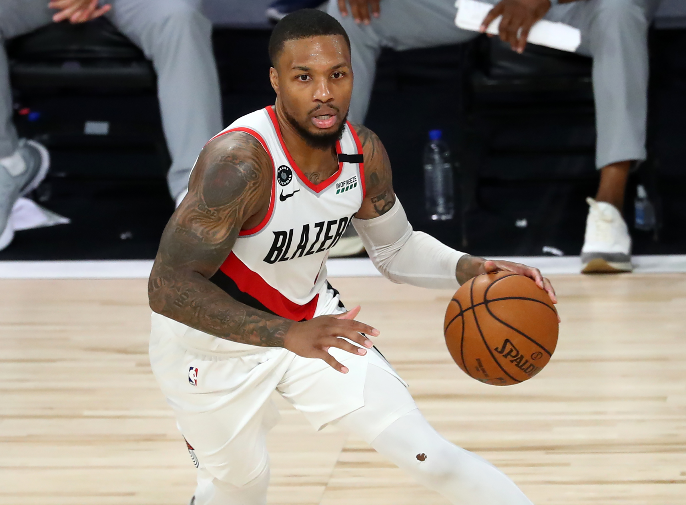 Portland Trail Blazers guard Damian Lillard dribbles during the second half against the LA Clippers in an NBA basketball game at HP Field House at ESPN Wide World Of Sports Complex on August 8, 2020 in Lake Buena Vista, Florida.